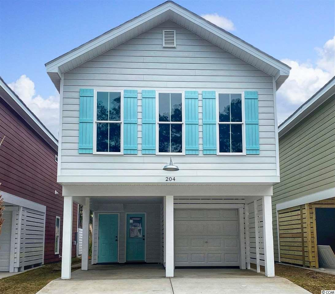 """This is one of the last two available! **Developer close-out sale** Without a construct-to-perm loan, we plan to deliver a completion date around February. Less than one breezy short mile from the beach, and a golf cart path to the Garden City Pier, this home is nestled in a quaint 30 home community with excellent amenities such as a swimming pool and more! This home features Quartz counter-tops in the kitchen, under-mount """"SS"""" sink, and an appliance package. The white subway tile back-splash accentuates the quality of the kitchen! Bathrooms include Carrera Marble solid surface counter-tops with under-mount sinks and ship-lap walls! Cathedral ceilings in the master bedroom give an open and spaciousness feel to this home. To keep the""""coastal cottage"""" feeling throughout, the living room is accented with a ship-lap wall. But what really makes this feel authentic is the laminate flooring wall to wall; except wet areas where 18 x 18 modern tile adorns the floor. There are far too many upgrades to include in this description so contact your realtor or myself to schedule a showing!"""