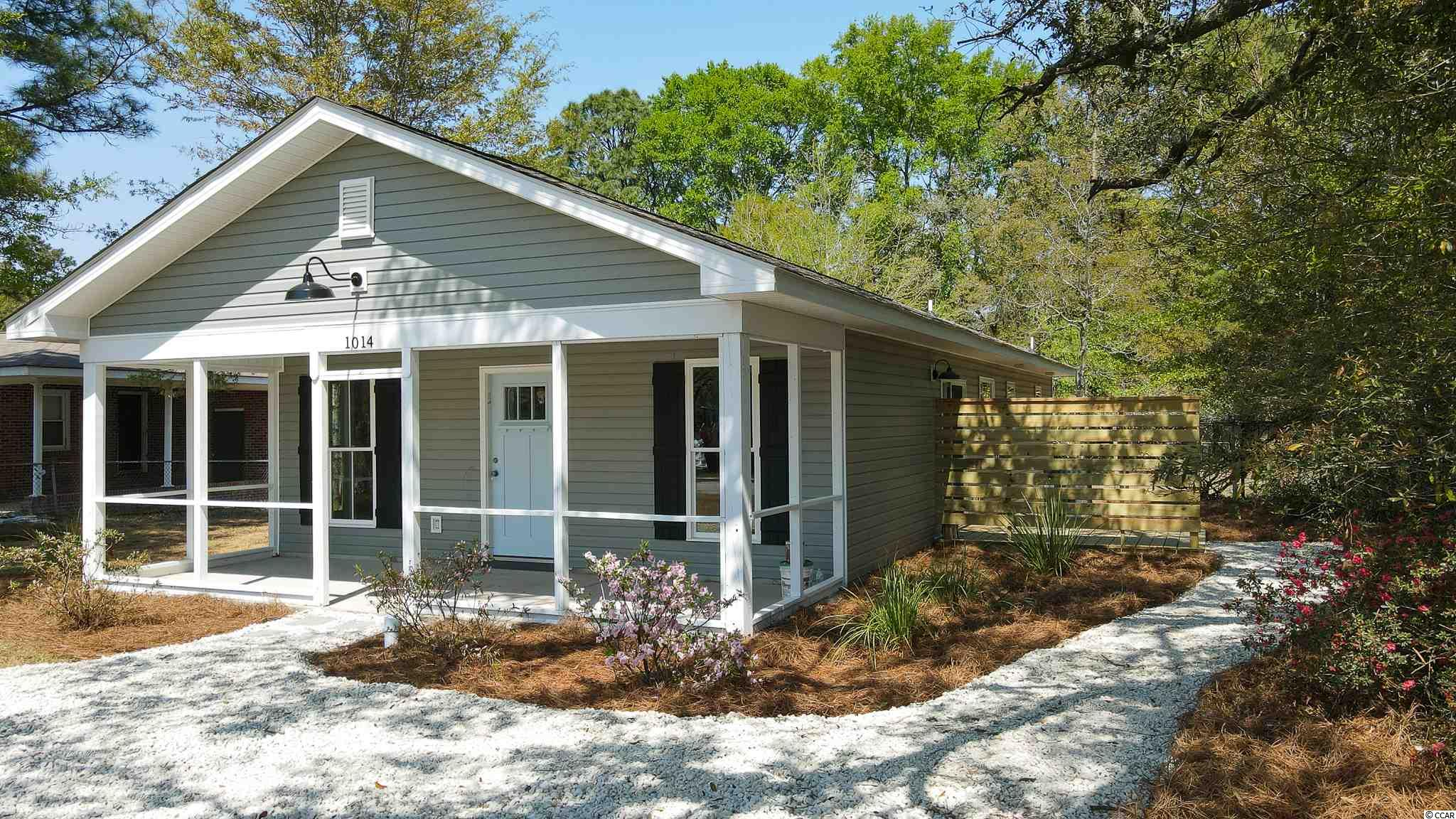 "Location is crucial when choosing the right home wouldn't you say? Tucked between HWY 17 and the Winyah Bay, you are located at an ""arms reach"" of  shopping, restaurants, hospitals, harbors, three airports, two technical colleges and three universities. 10 min from Georgetown, 45 min from our nearest metropolitan areas in either direction, south to Charleston or north to Myrtle Beach.  This home-site was previously used as a fertile plot of land to grow muscadine grapes. We plan on incorporating that same mature grape vine into the back yard of the home! Shiplap accent walls, GE Appliance package, large tubs, cathedral ceilings,spacious 24' x 8' front porch, and more. Call today!!"