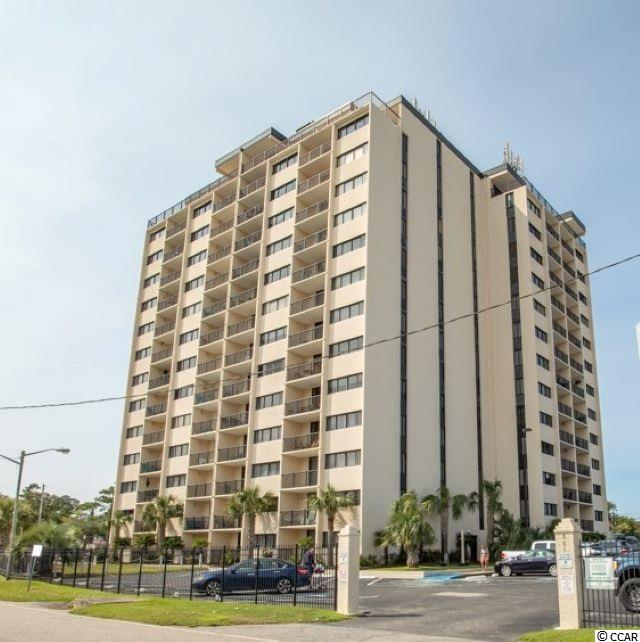 This large 2BR-2BA condo has tons of storage, a low HOA and is under 500 steps to the beach! Fully furnished with 2 master suites, this unit could be a great primary or secondary home. Drop your beach items off in the full-size laundry room located just inside the door and come on it to relax your worries away. Both master suites are spacious rooms, one with a full size closet and the other with a walk-in closet. If you chose to rent this unit, there is a locked owners closet as well. The galley kitchen has plenty of count space for prep and has an open view to the dining and living area. From the balcony you can enjoy a view of all the amenities and a partial ocean view. Holiday Towers is located in the heart of the Myrtle Beach! Leave your car in the Holiday Towers parking lot and walk to restaurants, an amusement park, a water park and much more. Also, a short drive to the Myrtle Beach Airport, Broadway at the Beach, Market Common and the Sky Wheel. HOA fee includes everything but your electric. Amenities include a beautiful pool and kiddie pool, hot tub, grill and picnic area and tennis and basketball courts.