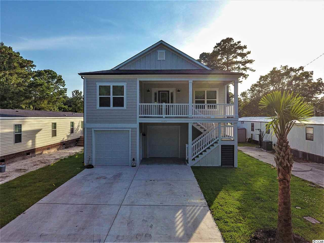 This 3br 2 bath raised beach house can be doubled in size by closing in under the house for living and storage or garage. The Grove has no HOA and is just a little over a mile to the warm sunny Cherry Grove Beach. Hop on your golf cart and ride to the beach, shopping, restaurants and more. It's also just a few blocks away from the ICW. Call today and pick out your colors and flooring. Pictures represented are of a model home.
