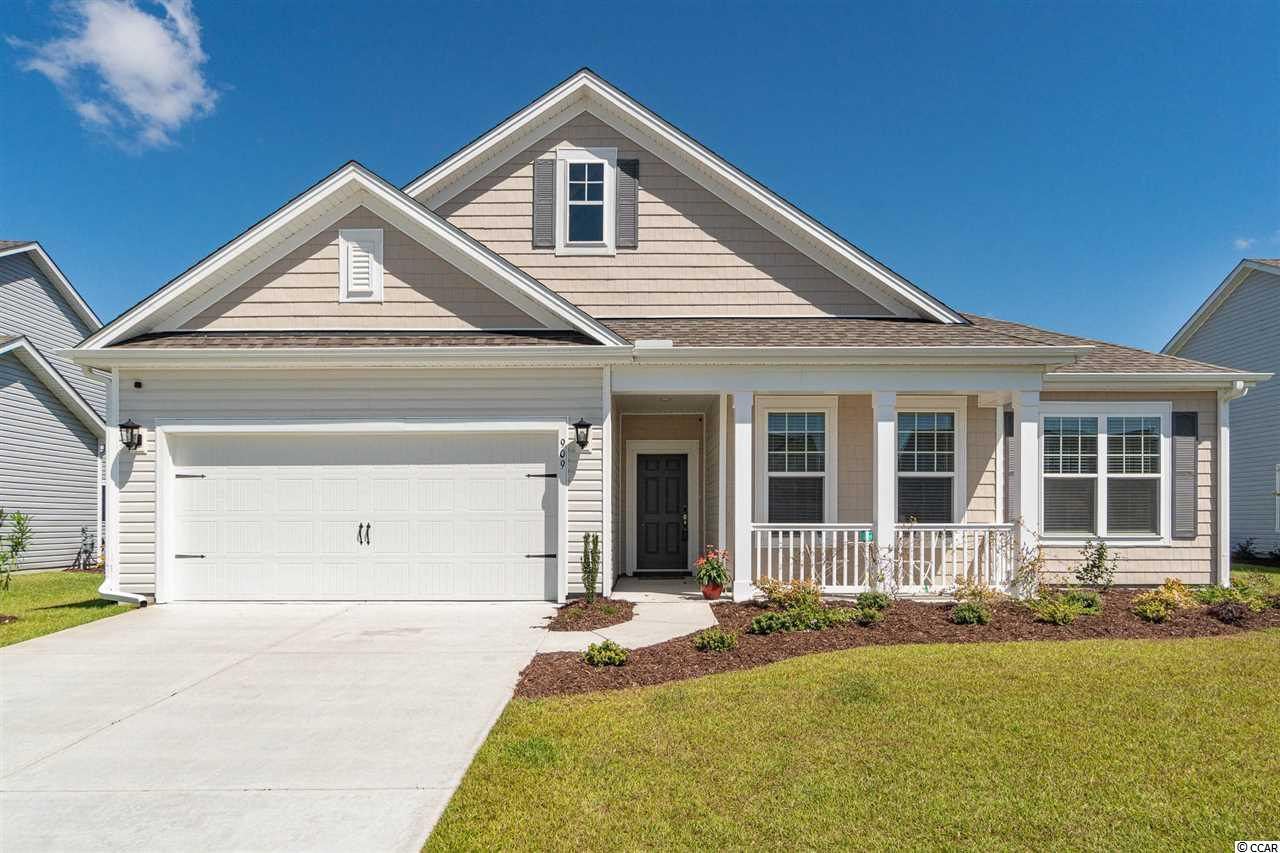OPEN HOUSE - SAT - 9/26 - 12-3 PM and SUN - 9/27 - 1-4 PM.  MOVE-IN READY! LIVE YOUR DREAM LIFE AT THE BEACH!  Located in Belle Mer, a natural gas community, this Oxford floor plan boasts a magnificent water view, a spacious home site, a fenced-in backyard and an open concept floor plan with 3 bedrooms, 2 baths, a study with French doors, a separate laundry room, a southern front porch, a covered rear porch, and attic storage. The interior features a spacious walk-in tile shower in the master bath, a Bay window in the master bedroom, window blinds throughout, crisp white kitchen cabinets with roll-out shelves, Ice granite counter tops, LVP flooring (low maintenance, water resistant, durable), a lawn irrigation system, and gutters.  Located in a section of the neighborhood where construction has been completed.  This home is 100% Energy Star Certified which creates a more comfortable home with a lower utility cost. Belle Mer amenities include Colonial reproduction street lamps, sidewalks, a pool, clubhouse, and exercise room. Belle Mer offers a premier location across 17-Bypass from two large shopping-dining venues, quick access to Market Common, the public beach access parking in Surfside Beach, Myrtle Beach, and Myrtle Beach State Park.  Conveniently located between Myrtle Beach and Murrells Inlet between Highway 17-Bypass and 17-Business. Don't delay, book your showing today!
