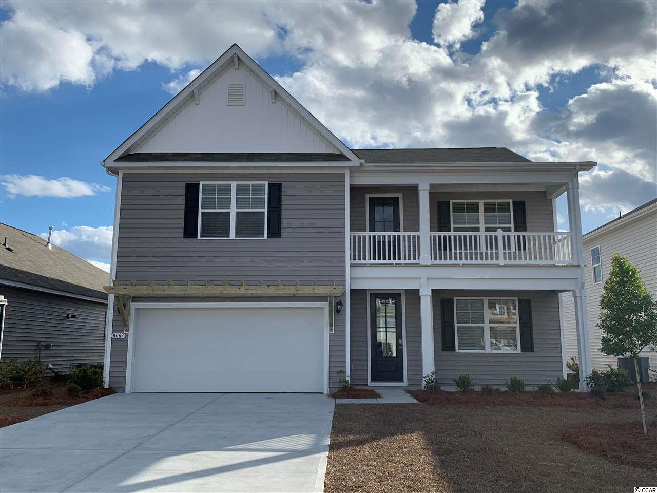 "This popular Tillman plan will give you the perfect mix of indoor and outdoor living featuring a large front porch with a second floor balcony above it and a rear patio overlooking the pond! Gourmet kitchen with sleek granite, 36"" staggered cabinets, and stainless Whirlpool appliances including a gas range. Beautiful wide plank laminate flooring flows throughout the dining room, kitchen, and living room. The first floor primary bedroom boasts a huge walk-in closet and en suite bath with a double vanity, 5' shower, and linen closet. Upstairs you will find a generous loft area, four additional bedrooms, and two full bathrooms. One bedroom is a self contained suite with direct access to a bathroom. It gets better- this is America's Smart Home! Each of our homes comes with an industry leading smart home technology package that will allow you to control the thermostat, front door light and lock, and video doorbell from your smartphone or with voice commands to Alexa. *Photos are of a similar Tillman home. (Home and community information, including pricing, included features, terms, availability and amenities, are subject to change prior to sale at any time without notice or obligation.  Square footages are approximate.  Pictures, photographs, colors, features, and sizes are for illustration purposes only and will vary from the homes as built.  Equal housing opportunity builder.)"