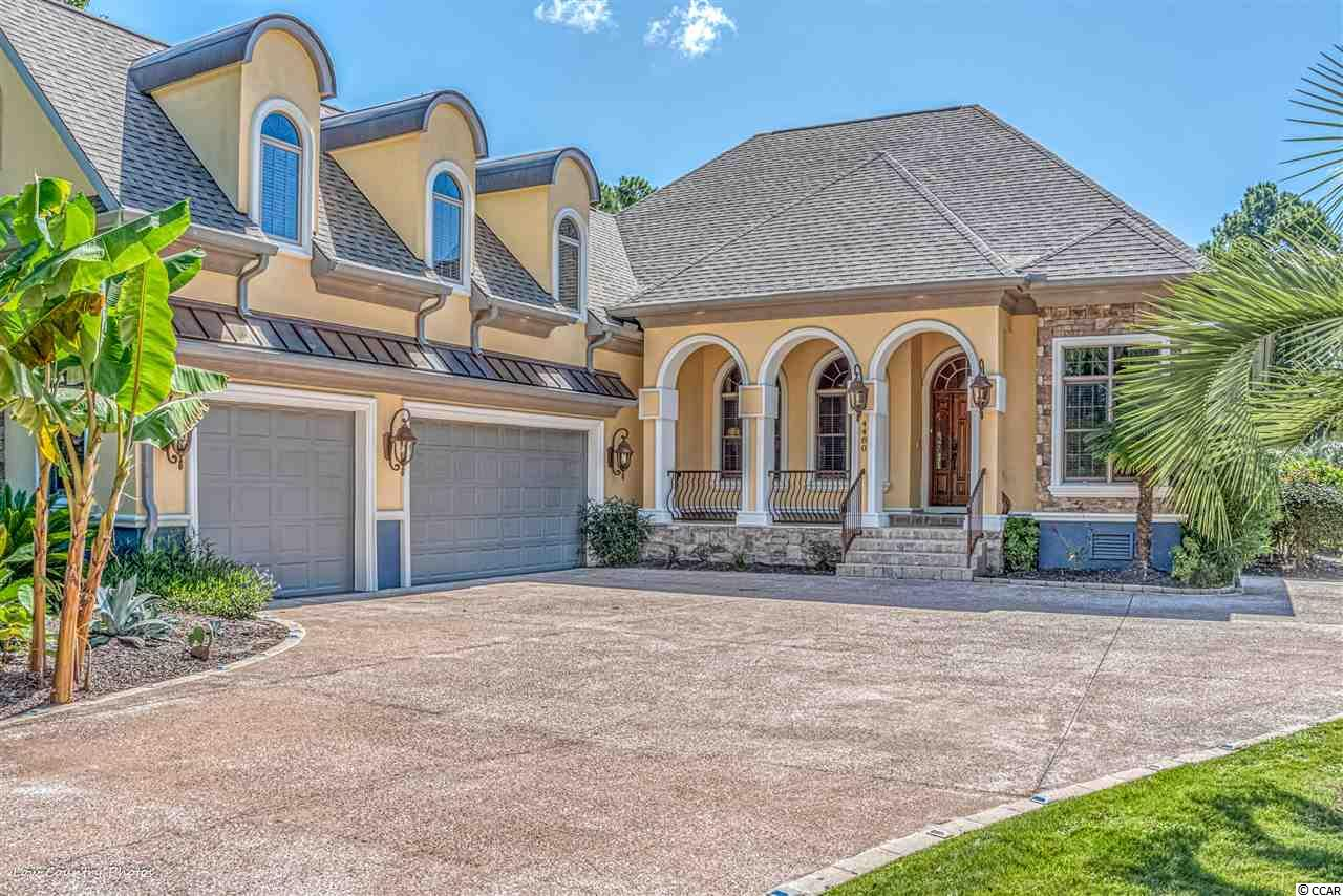 If you have been in search of an exceptional custom-built home in a premier golf course community, then this property is precisely what you have been looking for!! Truly a remarkable home with many upmarket features and situated on a corner lot offering peaceful privacy and everyday tranquility. As you arrive at 4480 Portrush Trail you notice the expansive driveway leading to a 3-car garage. As you enter the home, the features immediately capture your attention, from the 10'-12' ceilings, propane gas fireplace in the great room with marble framing, 8' solid core doors, custom cabinetry and trim work throughout, a spacious and extremely functional kitchen that includes a 6 burner range, a double oven with cooktop griddle, a breakfast bar, breakfast nook and a trash compactor. The covered and screened lanai is ideally positioned just off the breakfast nook area where you can enjoy your morning cup of java or your beverage of choice in the evenings. The fully equipped outdoor kitchen is easily accessible from the great room or the lanai with a covered Tiki hut for enjoying outdoor dining. This executive outdoor kitchen includes a 2 burner stove top, large built in gas grill, condiment trays, mini refrigerator and wet bar. Additional unseen features include a central vac system and a security system that you can get connected for your security. An oversized master suite has plenty of room for a king size bed as well as having a more than ample sitting/dressing room. The ensuite master bathroom is also oversized and features a walk-in shower, jetted tub, and double vanity sinks. The guest bedrooms are a split floor plan with each bedroom having its own full bathroom. A bonus room over the garage is currently used as a bedroom with its own full bathroom. A distinctive primary feature of this home is the custom designed pool with a soothing cascading waterfall to keep the water circulating. You will genuinely appreciate and enjoy the beauty of the lush back yard gardens, w