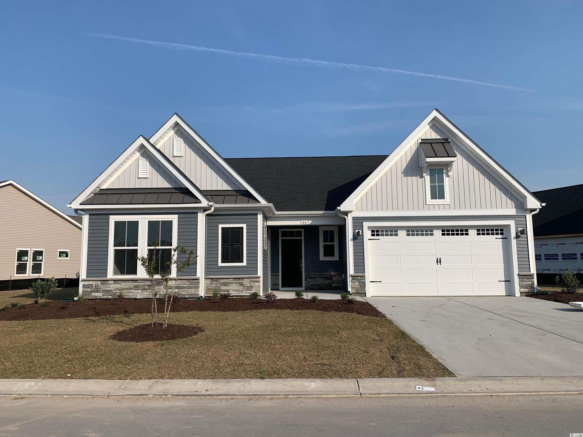 The Seashore floor plan is located in Seaglass Village of Bridgewater! The spacious, single level home features coastal inspired architectural accents, outdoor living area and an extended garage. A covered front porch welcomes  you home to a large, inviting foyer. Split bedroom plan offers plenty of privacy for owners and guests. This unique Seashore model has an open floor plan from the kitchen, breakfast area, great room and dedicated study. The kitchen in this home has a large gourmet island with double ovens. Bridgewater is a natural gas community. The Seashore has a gas furnace and gas tankless water heater. The Master Bedroom has been extended 5', has a trey ceiling with crown molding and two large walk in closets. Master Bathroom features a 5ft tile shower with bench seat, double vanities, water closet with comfort height toilets. Enjoy the Carolina breeze out on the covered rear porch. This home is a must see on water lot.  Schedule your appointment today!