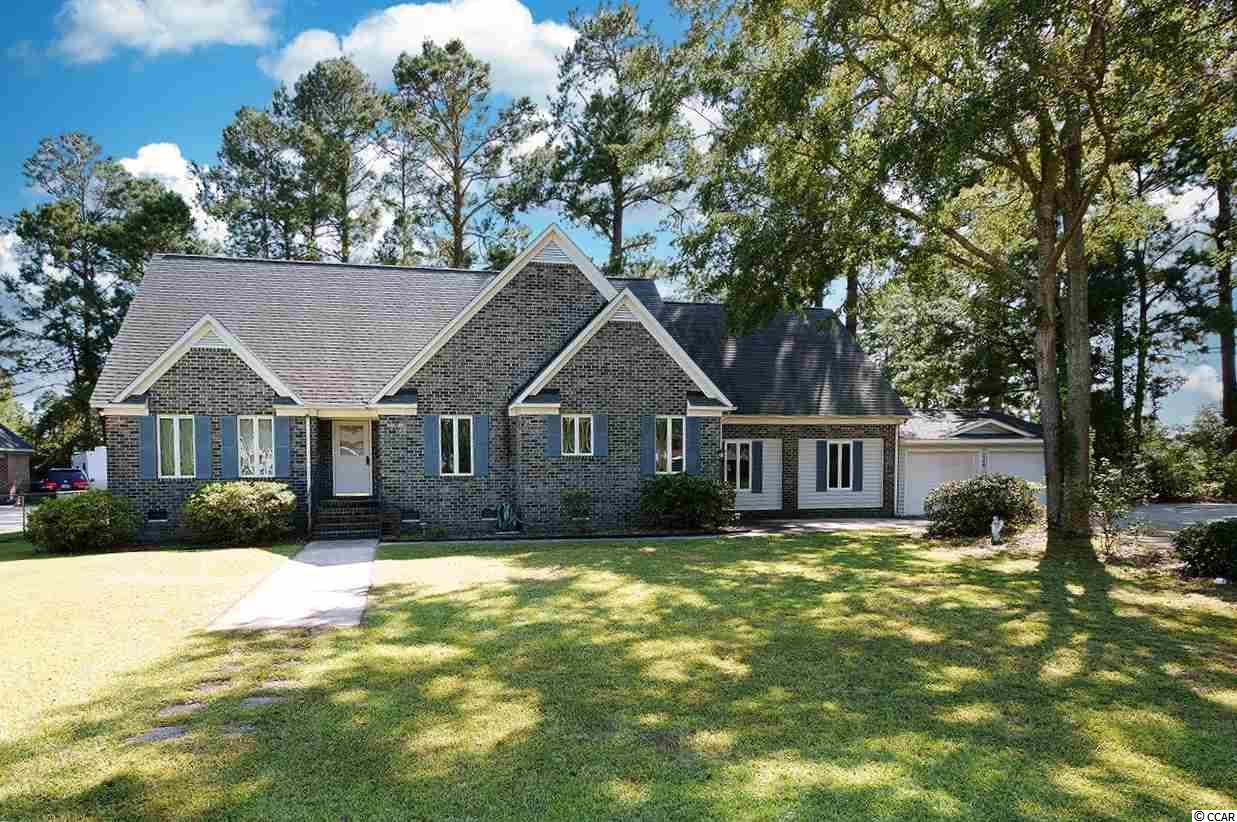 Look no further: Two-story brick home with a fenced-in backyard, located on a golf course, without homeowners association fees. This is your opportunity to own a 6br/3ba house in Conway, but only pay county taxes. Whether you have a growing family or are looking for rental income, this house can be adapted to suit your personal situation. The large master bedroom on the first floor offers two closets in the bathroom suite which has a walk-in shower and dual sinks. The screened porch opens onto the rear wooden deck from where you can view the golf course. Upstairs there is a flex room which could be used as the sixth bedroom or office, a full guest bathroom on each floor and there are two very accessible and oversized walk-in attic spaces as well. Both the kitchen and formal dining room are generously-sized and the sunken 19x15 recreation room offers endless possibilities for relaxing, crafting, study, indoor games or storage for your golf equipment. Plus there is an interior workshop and storage space via the garage. This house comes with ample parking in the attached two-car garage and more on the semi-circular driveway; all kitchen appliances convey as well as the washer and dryer. The roof was replaced in 2015 and new laminate wood plank flooring has recently been installed downstairs. Located with a view between the 9th and 10th holes of the Hackler Golf Course, in the Coastal Heights neighborhood, this corner lot is surrounded by mature landscaping. You will enjoy an oasis of privacy and the convenience of city living. Both Coastal Carolina University and Horry-Georgetown Tech are located within walking distance, making this property suitable for students, college professors or professionals associated with the local hospital and medical facilities. This home is less than 5 miles from downtown Conway which offers boutique shopping, numerous dining choices, the Riverwalk and entertainment options. At the same time you have the proximity to Highway 544 and 501 fo