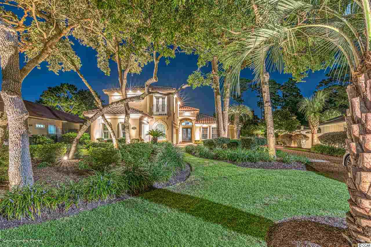 This beautiful Mediterranean Estate Home is the former model for Classic Homes. The house is ICF Fortified Construction, with high-impact windows. Vaulted ceilings and the open floor plan offer tons of natural light.  Affording you three bedrooms, three full bathrooms, one-half bathroom, home office, and a three-bay garage, 7563 Siena Boulevard has all the upgrades and extras you want. Nestled quietly in Siena Park, this house sits on one of the Grande Dunes most beautiful homesites. Accenting the extensive palm trees, tropical plants, and a Butterfly Garden is a large tranquil park in the front of the home.    Once you step into this very secluded, privately walled off backyard, you'll think that you have arrived at a Tropical Resort on vacation. The customed landscaped backyard is ideal for entertaining friends and family or just for enjoying a relaxing moment in your Spa / Pool.  Within the past 18 months, there have been extensive upgrades and enhancements to the home. A shortlist of them includes two newly installed Carrier High Tech HVAC Systems, pool resurfaced with pebblestone texture, hardwood floors in the Owners Suite, fans, fixtures, plantation shutters, custom closets, and the list goes on.  As you enter through the elegant but robust front entrance, you'll walk into a grand foyer facing the formal living room with its soaring customed painted ceilings overlooking your majestic backyard and pool. Must see this one to appreciate the quality, details, and beauty.    7563 Siena Boulevard is located in one of South Carolina's most pristine communities, Grande Dunes. This 2200 acre master-planned development stretches from the Intracoastal Waterway to the Atlantic Ocean.  Ownership of this property grants you access to a host of world-class amenities.  The 25,000 square foot Ocean Club has an oceanside pool, dining room, snack bar, meeting areas, golf cart parking, and even towel service on the beach during the season. Rounding out the long list is two 18-ho
