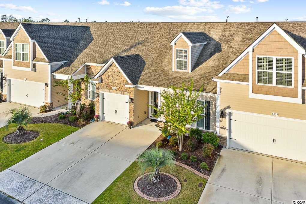 Don't miss this 4 BD, 3 BA townhome with a private garage and a gorgeous lake view in the highly sought after community of Parmelee in Murrells Inlet. This is a natural gas community. Open concept floorplan has two bedrooms downstairs including the master bedroom. Unit has been meticulously maintained and hardwood floors on the main level including the bedrooms. Kitchen has granite countertops, tile backsplash, plenty of upgraded cabinet space, stainless steel appliances, Natural Gas Range, pantry, & breakfast bar. Kitchen overlooks the spacious living area and wide lake views from inside.  Master suite is just off the living area and has a 2 walk-in closets and sliding doors leading to the covered patio. Master bath has a double vanity, shower with two seats, & linen closet. There is also a 2nd bedroom on the main level with a bath close by. Split bedroom plan. Just off the foyer are stairs leading to two bedrooms and a full bath. Large covered patio allows you to stay cool in the summer months while having coffee or entertaining with friends while watching the relaxing lake view. Home is wired for generator hook up. Security system. Doorbell camera, entry sensors, motion sensors, indoor camera, keypad, water sensor and key fob.  Close to shopping and restaurants. Community pool and the HOA take care of the lawn so you can relax!!! Don't miss your chance before it's too late - priced to sell and will not last long. If you are looking for a place ready to move into, seller would also consider selling some of the furnishings. Close to the marshwalk and all the great food and activities in Murrells Inlet without the yard work.