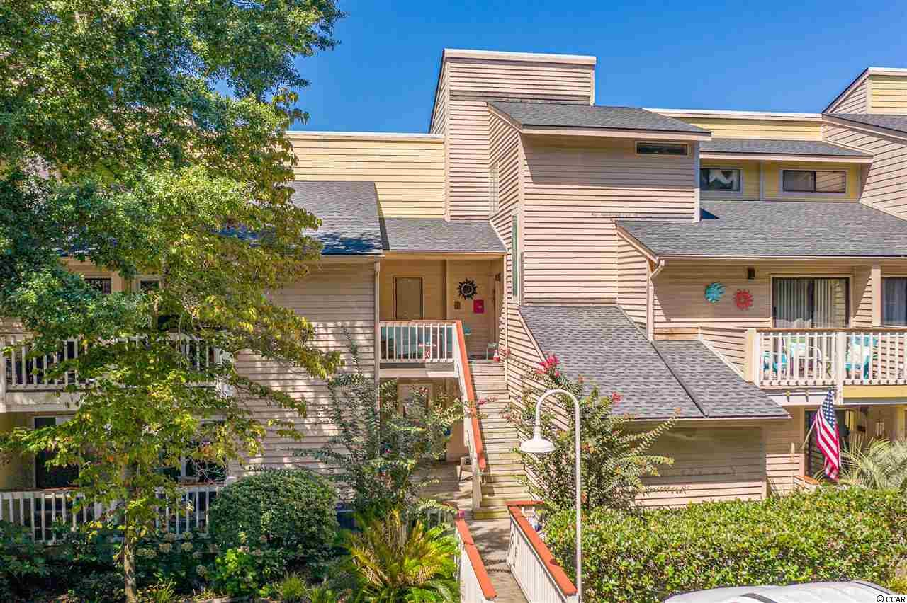 Come see the million-dollar view of the inlet from this lovely condo located in the peaceful community of Marsh Hills. This beautiful unit is being offered fully-furnished, and it's completely move-in-ready! The tropical decor gives it a beachy vibe, and the open concept is great for entertaining! As you walk into the living room, you will notice high vaulted ceilings and a real wood-burning fireplace! This is the perfect place to cozy up with your loved ones in those colder months. You can enjoy your breakfast at the bar or you can step outside onto one of several private balconies. The master suite is located on the first-floor level, and it features a balcony where you can sit back and relax. The washer and dryer are downstairs as well, and they do convey. You will find a loft that can be used as a bedroom upstairs along with two more full-size bathrooms and another huge guest room with a walk-in closet and a balcony overlooking the inlet. This would be such a magical place to unwind and read a nice book after a long day! This home ultimately has two master suites. The owners have maintained it very well, and they are even offering a home warranty for extra peace of mind. A new roof was installed in 2010 by the hoa. The large balcony off the living room is the ideal place to sip on some of your favorite exotic cocktails with friends while you enjoy the magnificent view of the marsh, and don't be surprised when you see several different kinds of unique birds. They love the water, and it's very common to spot all sorts of egrets, herons, and pelicans. You can also see the Dunes golf course from here, which is one of the most prestigious waterfront courses in the area! You can join the club and take advantage of their luxurious clubhouse, tennis courts, and active social events. This is definitely the place to be, and you don't want to miss out! You can take a dip in the pool or catch some rays on the deck. This is a very serene environment. There are lots of trees that provide plenty of shade, and there is a special grilling area. You can also get the opportunity to golf cart to the beach! Several homeowners have been able to store their carts behind the building. Pets are allowed, and they can enjoy the sunshine from all the balconies. You can go fishing off the Apache Pier or you can go check out Ocean Annie's Tiki Bar! They have great live music! There are several fantastic restaurants nearby like Baron's Steak & Piano Bar and Bimini's Oyster Bar. Arcadian Dunes golf course is right around the corner as well. There are numerous places to shop, too! The Tanger Outlets are only a few minutes away! You will never run out of things to do! This area has everything you could ever want, so what are you waiting for? Schedule your showing today! Square footage is approximate and not guaranteed. Buyer is responsible for verification.