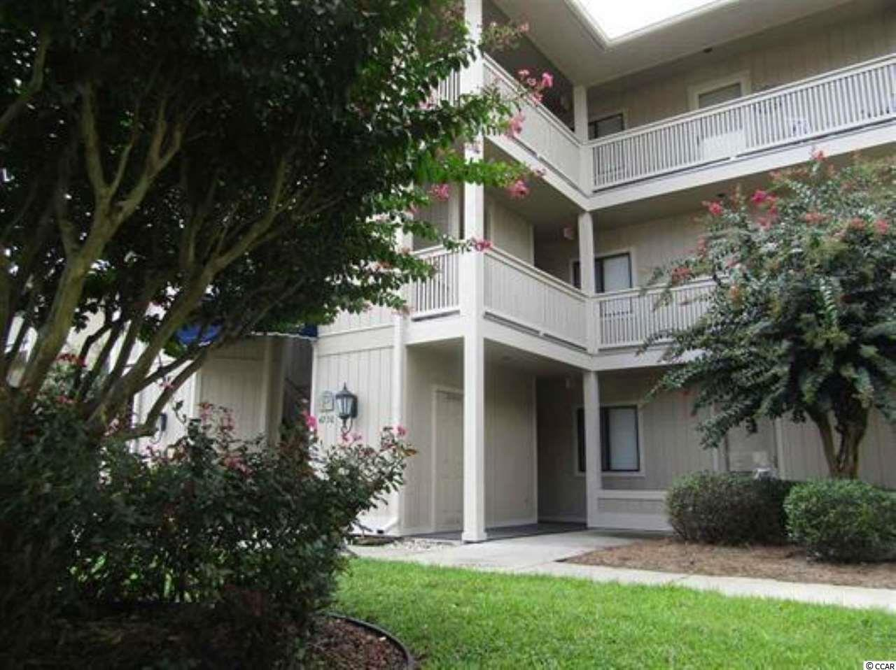 Bright, open floor plan in this sought after first floor condo.  Nice laminate flooring.  Over-sized screened porch with ceramic tile and view of lake.  Storage closet.  Great location close to restaurants, shopping, golf courses, entertainment, medical and more.  Beach and the Intracoastal Waterway a short drive away!