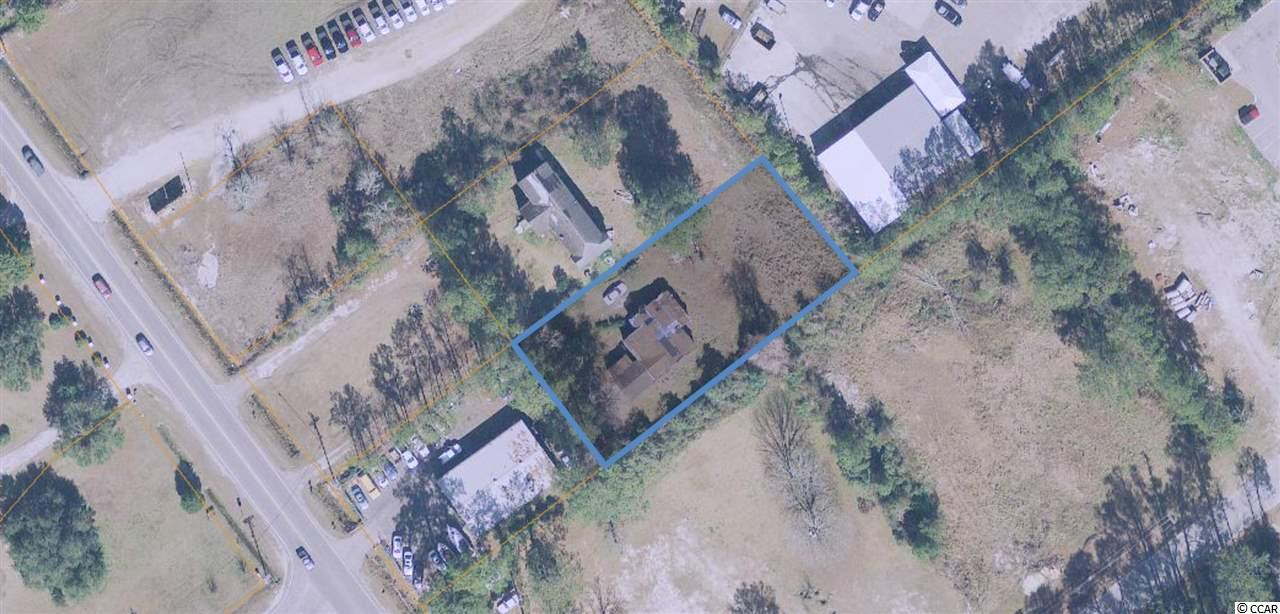 Great price on this smaller commercial parcel located directly on Sea Mountain Hwy in Little River.   Perfect size and price for a small commercial development or even as a residential use. There is an older structure on the property that will convey.