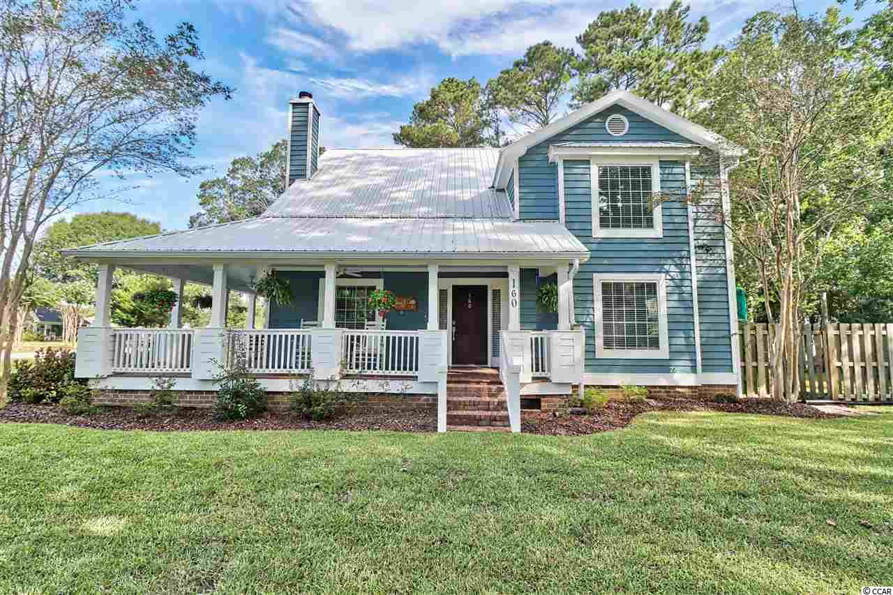 Enjoy an iced tea on this wrap around porch overlooking a large beautiful corner lot in the quiet community of Pawleys Retreat. This Charming Low Country Home was Totally Renovated in 2018 with all the bells and whistles, 50 year metal roof, Energy Efficient Windows, dual HVAC system and freshly painted exterior. Beautiful kitchen with Granite countertops, slow close custom cabinets, tiled backsplash and Fingerprint resistant stainless appliances. Oversized laundry room has shower stall and utility sink. Large 1st Floor Owners Suite nicely appointed with walk-in closet and deluxe bathroom with huge tiled shower. Two Large bedrooms upstairs could easily be made into 3. Remodeled Jack and Jill bathroom upstairs as well.  Air-conditioned workshop connected to rear of garage with tons of storage and shelving. Private back yard great for entertaining with patio and firepit area. Close to neighborhood park. Low monthly HOA that includes boat and trailer storage. Spectrum internet and cable Package at low Community pricing. Minutes to the beach, shopping & golf!
