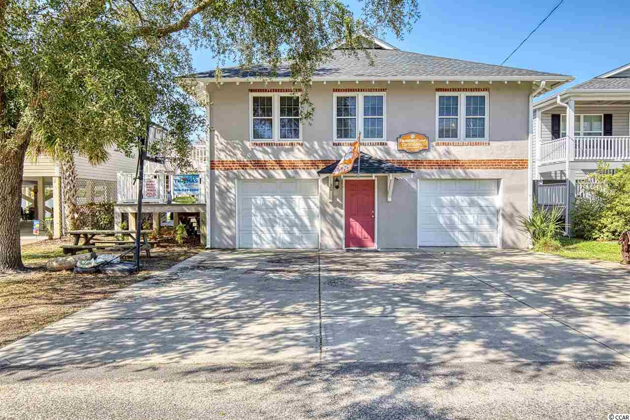 This spacious 5 bedroom, 3 bath beach home is only a block and a half from the surf & sand of Cherry Grove. It has a gourmet kitchen with two full size refrigerators, stainless steel appliances, and granite countertops, new hvac, & new roof. This is a spectacular find to start your family beach traditions! Extensively renovated with vinyl windows, trex decking and steps, vinyl railings, stainless steel appliances & much more. This is absolute must see! Outdoor features include your private backyard pool with an outdoor 6-person hot tub! Square Footage is approximate and not guaranteed.