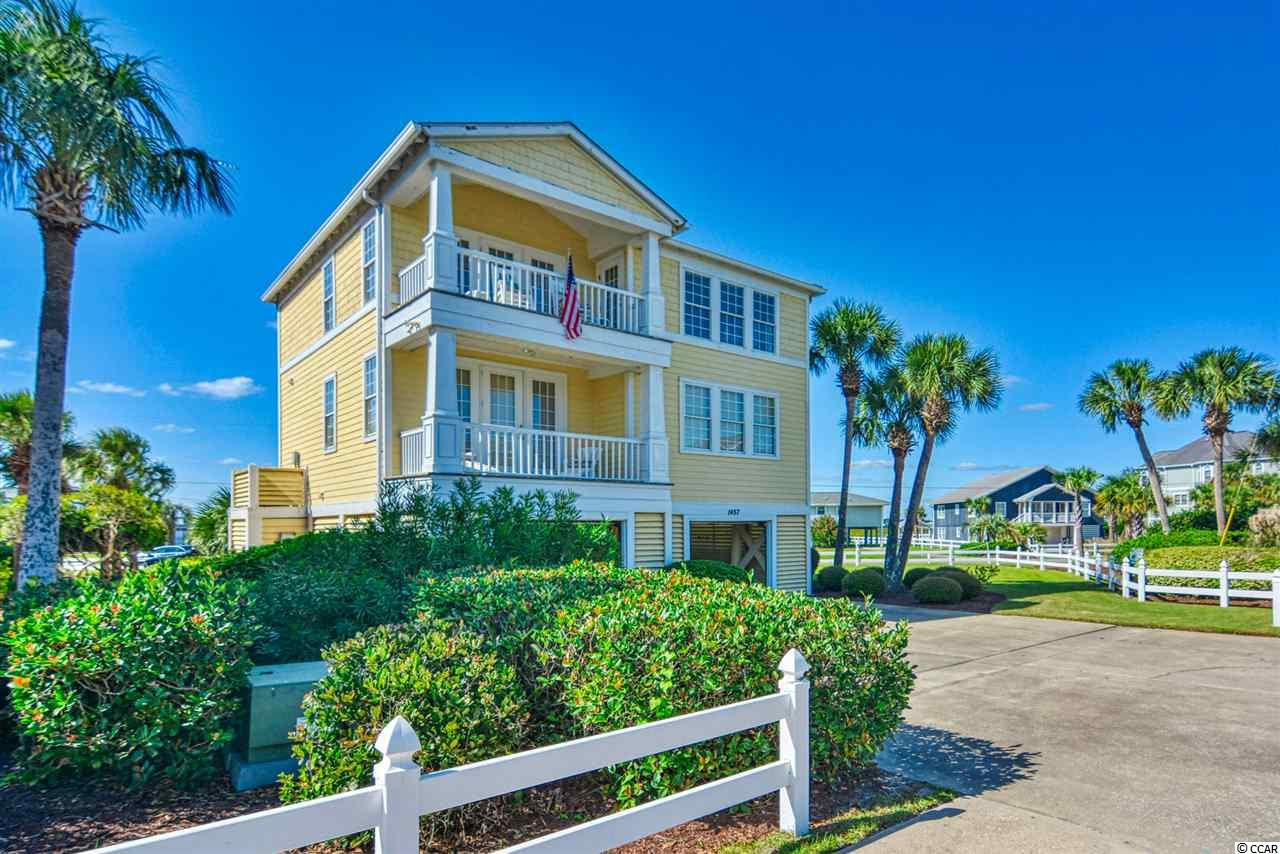View-ti-ful...the views are stunning, the best of the both worlds, enjoy the ocean in the morning and the sunsets in the evening with views of the inlet and the marshwalk from afar. You will not be disappointed with two porches on each level, front and back. This furnished 4 BR, 3 Bath is a second home but certainly could be a rental, short term or long term. Enjoy entertaining in this open floor plan with a fireplace for the chilly evenings located on the second floor with one of the two master suites. The kitchen has upgraded stainless appliances. This home offers 3 bedrooms and two baths on the first floor. You will appreciate the storage on the ground floor with a 3 car garage and workshop, lots of storage. Corner lot located in Seaport Village. HOA of 937.00 monthly includes water, sewer, garbage pickup, pest control. lawn maintenance, pool, exterior insurance including wind, hail and flood. HO6 is recommended for the inside.