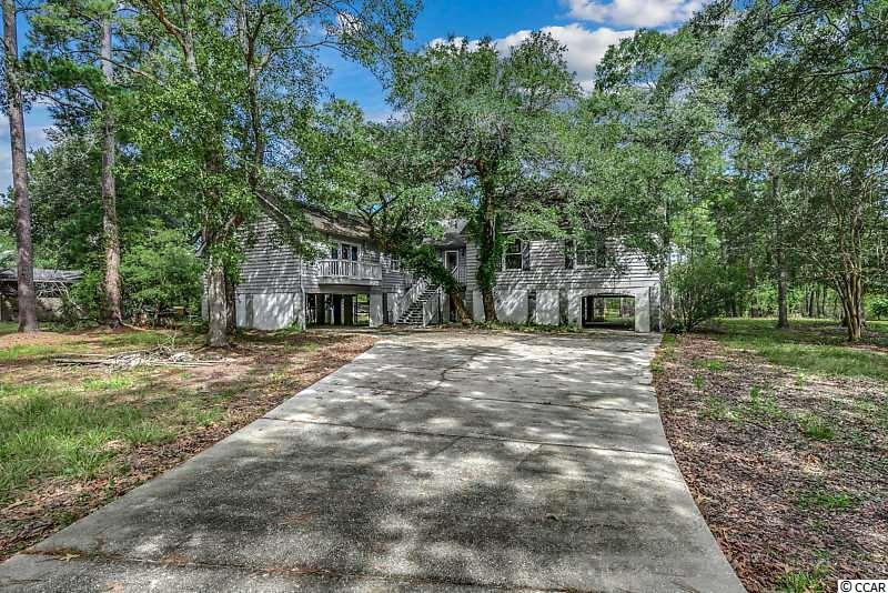 Perfect opportunity to own a piece of River Front Property.  This 3 BR/2BA home with bonus room is ready for you to make your own. Upon entering the home you will find 2 Family Rooms, both with a fireplace overlooking the Waccamaw River. A formal dining area opens into the kitchen where you will find lots of cabinets for storage and a breakfast nook. Plenty of room underneath the home for parking or storage. The home did not get water in it during the Flood in 2018. The duct work has been replaced.