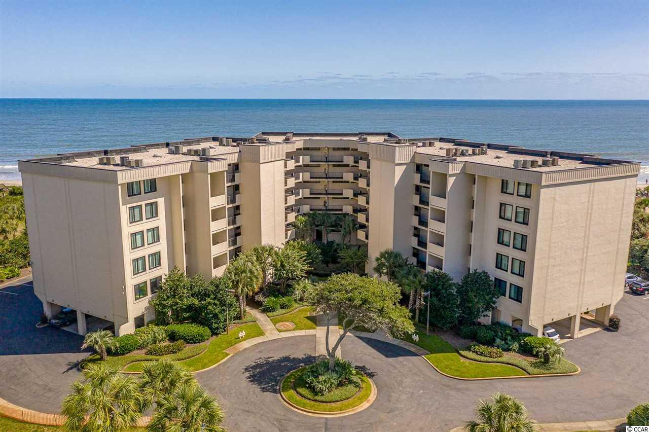 Incredible opportunity to purchase this immaculate 3 bedroom 2 bath ocean view condo with double balconies in Sandpiper Run at Litchfield By The Sea. Conveniently located on the first floor of the B building, Unit B-1-F comes fully furnished (with exception to a few owner personal items) and features unmatched interior upgrades like none other in the community ! The condo has  been completely renovated with upgrades that include Tuscany Chateau Travertine Tile throughout, smooth ceilings (no popcorn), crown molding throughout, oversized base boards/shoe molding, granite kitchen counter tops & vanities, top of the line stainless steel appliances, custom cabinets, upgraded wet bar with wine cooler, and much more ! Spacious master suite with a private ocean view balcony, custom wall cabinetry, and renovated master bath w/ double sink granite counter top vanity & stand up tile shower. Never been rented and meticulously cared for as it is in pristine condition. A must see to be appreciated ! Covered parking with adjacent storage area is included on the ground level. Litchfield by the Sea amenities include private beach access & oceanfront clubhouse, walking & biking trails, tennis courts, fishing pier, and crabbing dock. Just a short 70 mile day trip to historic Charleston, SC or 25miles to all the attractions of Myrtle Beach. Call today for a showing!