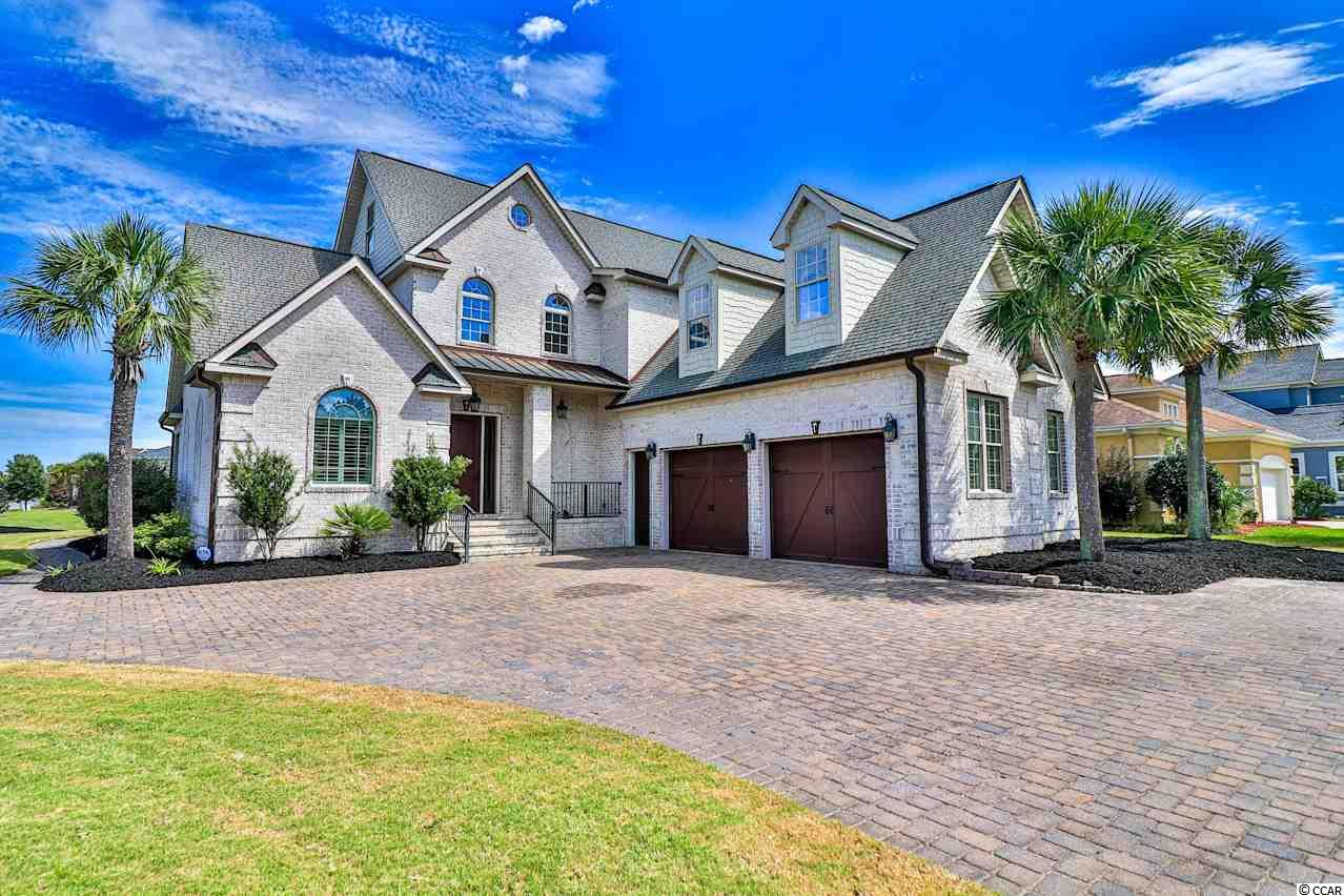 This LUXURIOUS all brick family home is located on almost a full half acre CORNER LOT in the prestigious gated community of Carolina Waterway Plantation! This 5 bedroom, 4.5 bathroom home features a spacious, bright, open floor plan and has everything you can dream of and more! The gourmet chef's kitchen features a custom back splash, stainless steel appliances, a walk-in pantry, a breakfast bar, a separate breakfast nook, and plenty of counter space! The spectacular vaulted living room features a wet bar, a warm stone fireplace, gleaming hardwood floors, beautiful crown molding, and LED lighting throughout! The elegant master suite features a large walk-in closet and an impressive master bathroom! This amazing home also features TWO large entertainment/recreation rooms, each equipped with their own wet bar, a formal dining room, and a custom built-in wine rack! You will enjoy the peaceful water views and the relaxing back porch perfect for entertaining! Carolina Waterway Plantation features an Olympic sized community pool, tennis courts, pickle ball courts, a play ground, AND a private boat landing & boat storage perfect for any and all water activities! Enjoy the breathtaking INTRACOASTAL WATERWAY views and great weather from the community gazebo! Don't miss out on this INCREDIBLE OPPORTUNITY!!!