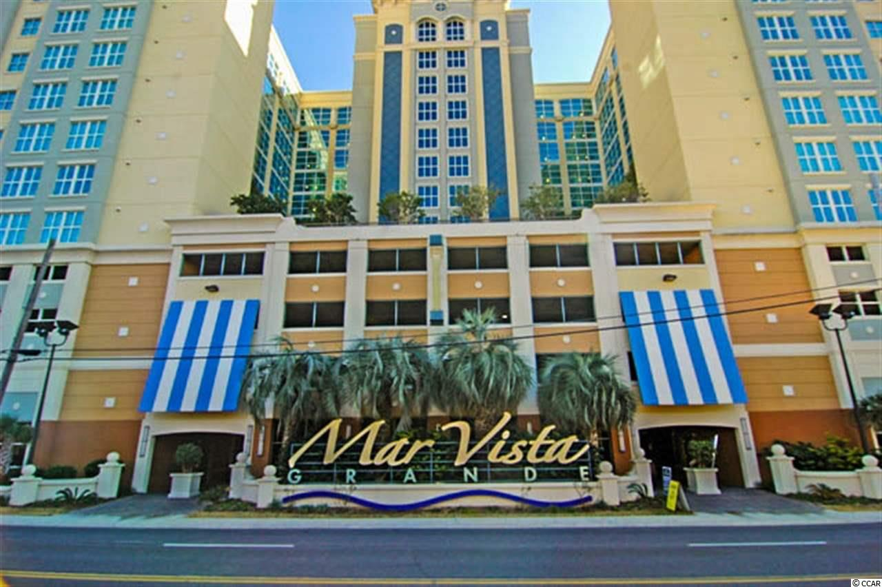 Located in North Myrtle Beach's premier oceanfront tower, Mar Vista Grande.  Almost 1,700 sq. ft., inclusive of almost 200 sq. ft. of glorious deck space overlooking the dunes, sea oats, beach, surf and the magnificent horizon of the Atlantic.  This three bedroom, three bathroom, oceanfront floorplan is quite spacious with a king size bed in the master and two queens in each of the two guest bedrooms.  The home has so many features -- nine-foot, smooth ceilings with crown molding, open concept floorplan, wooden cabinetry in the kitchen and all three bathrooms, granite kitchen countertops, stainless steel appliances, a large master suite with double vanities, walk-in shower and whirlpool tub.  Very well put together.  The Mar Vista Grande ocean front tower is probably one of the finest built buildings in North Myrtle Beach and is full of amenities.  Ocean front pool with kiddie area, lazy river and hot tub, as well as a temperature controlled indoor pool, kiddie pool and huge hot tub where the walls can be removed to open it up during the warmer times of the year.  The Mar Vista also features a very nice workout facility, homeowners lounge and a private sunset terrace.