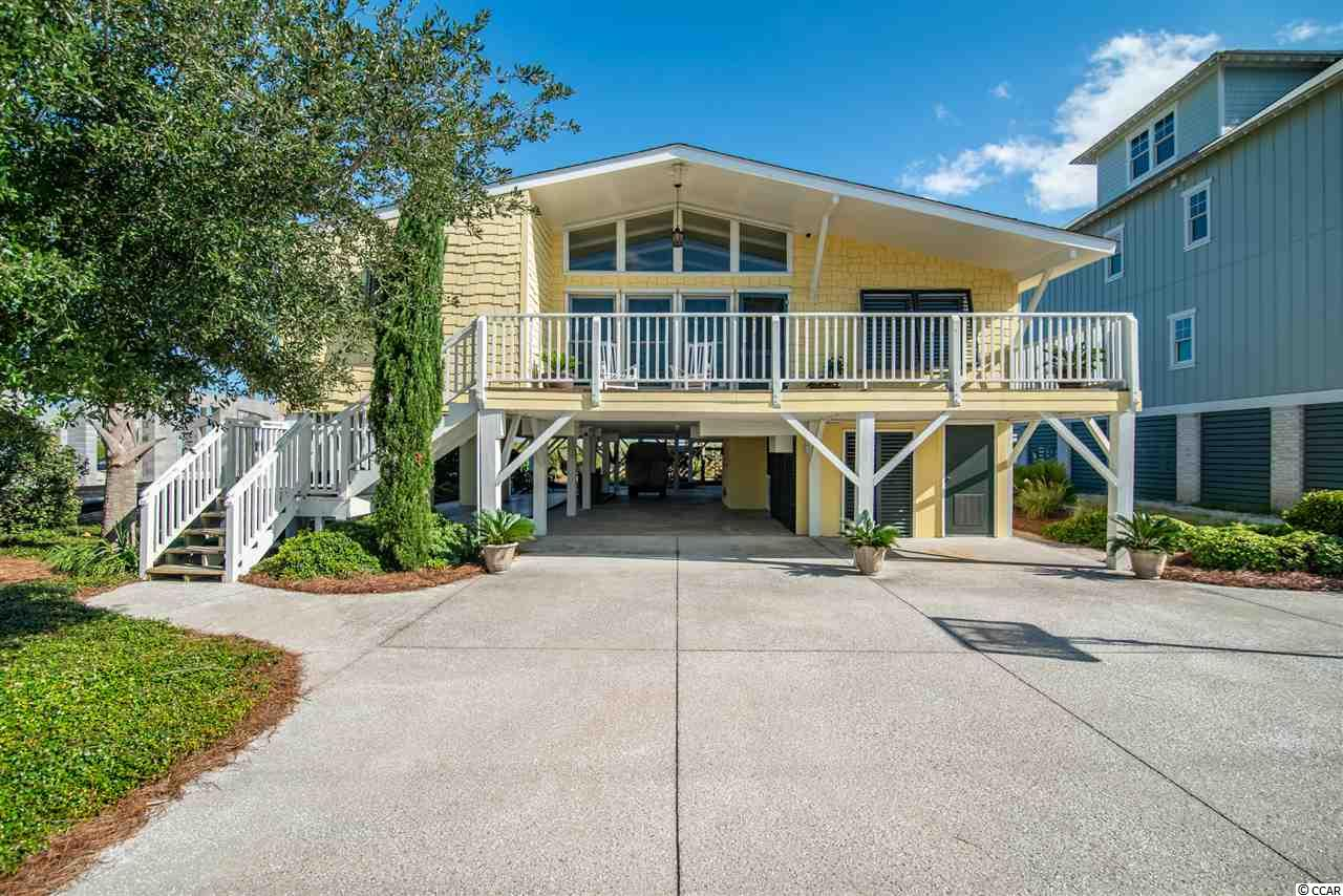 This Charming Oceanfront Cottage Nestled in Wide Sand Dunes at the North End of North Litchfield Beach immediately captivates at the Welcoming Front Entry Porch thru the Spacious Remodeled Interior, and on to the Expansive Ocean Side Deck with Sweeping Ocean Views. The Wide Open Living Space will easily Accommodate Family and Friends; and then cozy up for a Private Weekend Getaway.  A Redesigned Granite Kitchen with Stainless Steel Appliances, Hardwood Floors throughout, Wood Burning Fireplace, and Vaulted Ceilings all Accent the Well-Designed Beach Style Interior.  Enjoy Extensive Outdoor Living complete with Shuffleboard, a Barbecue Corner, Hidden Sitting Areas, Raised Gardens, and 2 Outdoor Showers.  The Pristine White Sand Beach awaits just a few steps from the Private Beach Walkway.  Do not miss out on this Opportunity to own a Piece of Pawleys Island Oceanfront Paradise Completely Furnished and a Turn-Key Delight.