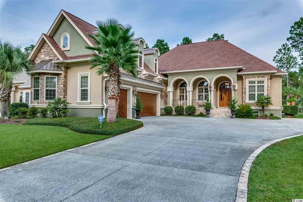 The finest home along the Grand Strand at this price point! This 4Bed, 4.5Bath estate at the Legends is perfectly situated with a view of the 8th Fairway of the Parkland Golf Course. This custom home community features 3 onsite golf courses, an owners Clubhouse, a pool, hot tub, tennis courts, walking trails, on-site restaurants, and so much more. This elegant split floor plan home offers the perfect space for entertaining or relaxing. Cook like a professional in the spacious kitchen, complete with an 8 burner gas range with dual ovens, a built in convection oven with warming tray, and a freestanding ice maker. The screened in patio also features a full gourmet outdoor kitchen, with all of the necessities, plus more. In the dining room, you will find beautiful coffered ceilings, with lighted tray ceilings in the living room and master bedroom. Each bedroom is completed by its own private ensuite bathroom with custom vanities. The master suite not only offers an oversized luxurious bathroom, but also a multifunctional office/sitting area. Additional features of this elite home are a tankless water heater, a central vac system, dual zoned HVAC system, a security system with exterior cameras, and a three car garage. Don't miss your chance to own this spectacular home at an amazing price.