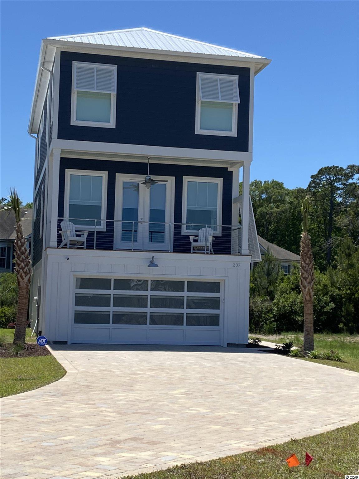 Raising The Pawleys Island Lifestyle to A Whole New Level!  Clam Bake Cove features 33 homes within a planned community.  3 bedrooms, 3 baths with garage and elevator featuring a contemporary coastal style defined by clean, smooth and subtle lines with natural materials, textures and color hues of blue and aqua.  Yet it is juxtaposed by its industrial design showcasing open spaces, high ceilings and neutral tones along with wood and metal utilitarian objects - a bit of edgy hardness with a modern coastal flare.  With low maintenance, the overall convenience and affordability of this community is hard to compare.  Located in the Center of everything!!!!  East side of 17!   Completion date March, 2019.  Photos are of on-site model. Partner is a S.C. licensed Realtor.