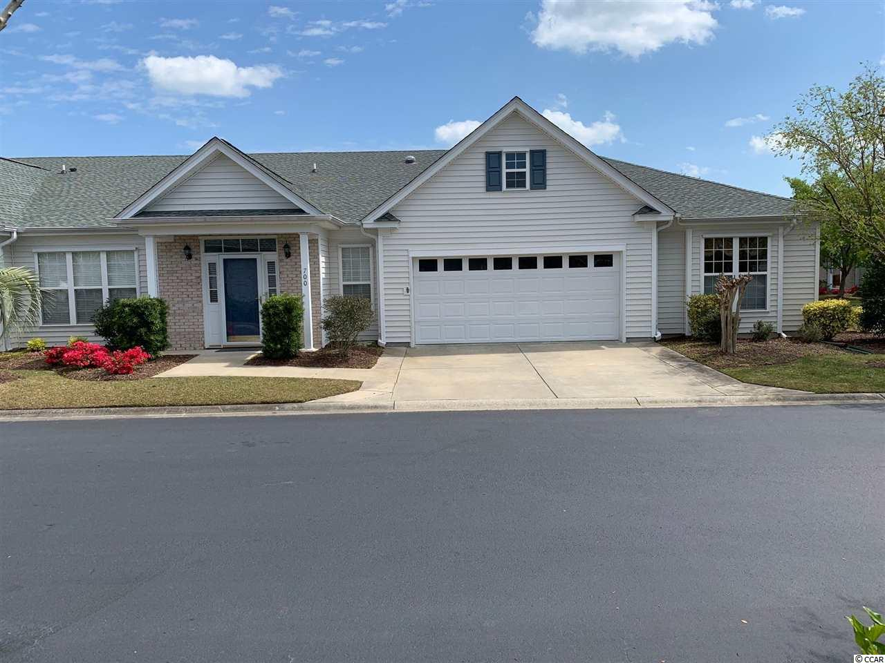 Where can you have a condo living with a 2 car garage?  One of a kind end unit villa in the community.  MUST SEE!  Freshly painted entire home including the garage.  This 2 bedroom, 2 bath with den is located in a prime location only 4 miles to the Inlet Marshwalk, and 7 miles to Huntington State Park, while within walking /golf cart distance to CVS Pharmacy, Publix Super Market @ Prince Creek and several other shops including the famous Eggs Up Grill.  The remodeled kitchen includes soft close cabinets, lazy susan, 4 pull out drawers, brand new Bosch dishwasher, built in desk, and Cambria counters tops with a sky tube for extra lighting.  The den has custom made built in book shelves.  Comfort height toilets in both baths.  Oversized marble shower with a full length bench seat and rain forest glass shower door.  Large master bedroom with tray ceiling, sitting area, and large walk in closet.  Laundry room with utility tub and entire home Kinetico water filtration system and water softener.  Ceiling fans in all rooms except dining area, Kitchen and 2nd bath.  Speaker system in great room and master bedroom.  2 car garage has extra heavy duty shelving on one wall.  Beautiful established neighborhood with lots of trees and walking areas.  Cross over the bridge to enter the pool over a pond full of turtles and ducks. Enjoy the crystal blue pool for a refreshing swim.