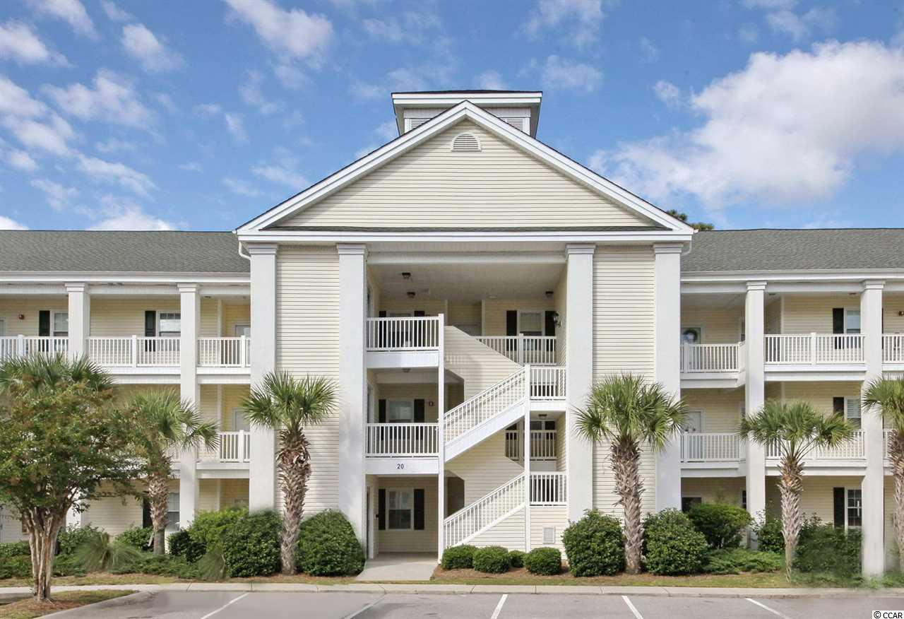 An IMMACULATE COASTAL INSPIRED CONDO in a PREMIERE COMMUNITY ON the WATER, creates a spectacular environment for you enjoy the lovely décor and resort amenities amid beautiful, natural landscaping. Enjoy warm Carolina sunshine in the gated community of Ocean Keys in North Myrtle Beach. An abundant collection of swimming pools, professional tennis courts, private clubhouses and an innovative fitness center invites residents to experience a variety of indoor and outdoor activities with friends and family. Observe the expansive views of birds soaring overhead and relax to the sounds of rain drizzling over the lake, from the delightful screened porch. Open the sliding glass door to allow the gentle breeze to filter into the condo. Located on the ground floor, this 2BR, 2BA furnished condo is conveniently located next to resort amenities and the beach. The kitchen has a bright and pleasant ambiance, with white cabinets, above cabinet lighting, granite countertops and an elegant breakfast bar area with modern bar stools. The white appliances in the kitchen include a brand new refrigerator in 2020, and a new dishwasher in 2018. Sophisticated, all new luxury vinyl plank flooring is found throughout the main areas of the condo, with soft, new carpet in the bedrooms. Relax and unwind in comfortable luxury, with a new HVAC system in 2019 and ceiling fans located throughout the condo. This turnkey condo is ready to be your vacation home, permanent residence or rental property. Schedule your showing today!