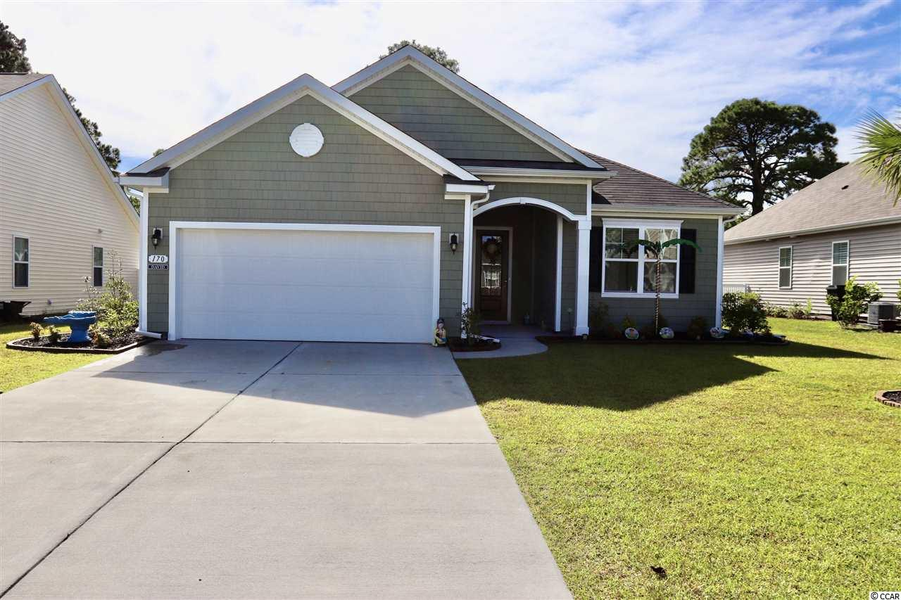Just a short golf cart ride to Surfside beach!  One mile walk or ride. The Eaton is one of the most popular 1-story floor plans. The open style ranch home offers 10ft ceilings. This plan is great for entertainment and if you love a lot of cabinetry and counter space, this home is for you! There is hardwood floors, granite counter tops, tray ceilings in the foyer and master suite, tiled backsplash, 2-inch faux blinds, refrigerator, and a 4 foot garage extension added to this home. This home is 1733 heated sq ft. It has beautiful a 9 x 26 ft. screened in porch!  Very nice yard with 5 palm trees. The Retreat at Ocean Commons is a natural gas community. Energy efficient with gas range, hot water heater and furnace. Move in ready!