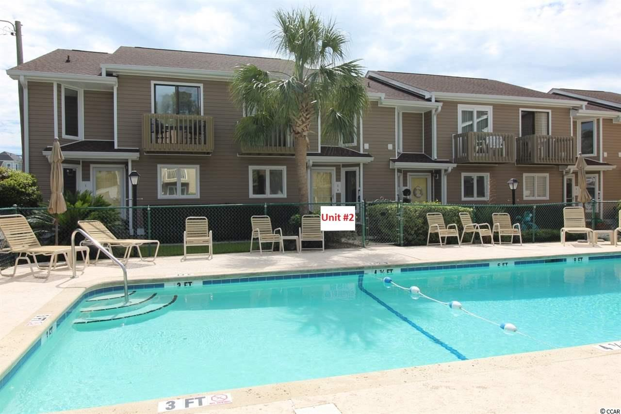 "This 2BR/2.5 BA townhouse is in the perfect location for a beach retreat. Kimbery Dunes is east of Hwy 17 Business, just a short stroll to the waters of the Atlantic Ocean. Conveniently located within walking distance to grocery stores, restaurants and all kinds of retail. This townhouse is a ""diamond in the rough"", a perfect opportunity for a new owner to put their personal touch on the needed renovations and improvements. The community pool is just outside the front door. There is a private courtyard in the back with an attached storage room. There are balconies outside the front and back bedrooms. The spacious family room (20'x18') has a fireplace. The master bedroom features a walk-in closet. There is a laundry room conveniently located on the second floor. There is attic access for storage. Downstairs ½ bathroom. Kimbery Dunes is a well-managed 12-townhome community. Vinyl siding replaced in 2014. New roof in 2013. Pool & deck resurfaced in 2014. The community allows owners to have golf carts. This property is ideal for either a primary residence of for a vacation home."