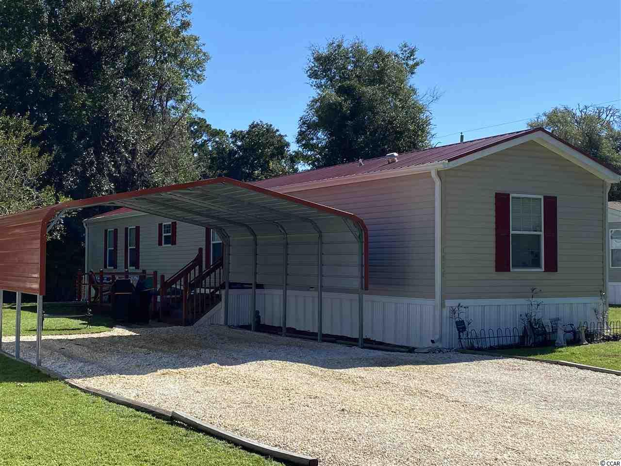 When you step through the front door it feels like home. There are many visible upgrades adding character to boast about, brand new metal roof, Luxury vinyl plank flooring throughout the home. Crown molding and chair rails throughout.  Split bedroom floorplan with 3 bedrooms and 2 baths. A cozy master bedroom sits on one end of the home with 2 good sized bedrooms and a full bathroom on the other side of the home Blinds on all windows convey.  Relax on the back porch overlooking the pond.  Brand new 2 car carport with pebble driveway.  6 years left on a 10 year warranty.  Roof has a lifetime warranty.