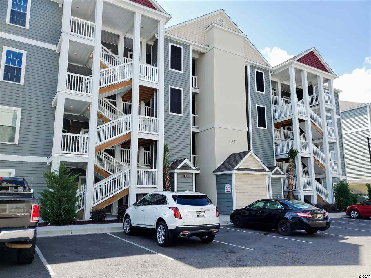 Opportunity to purchase this 7 months new move in ready condo in one of the most successful developments in the Myrtle Beach area.  Located in the very popular Village of Queens Harbour II development with elevators and outside storage unit.  Beautiful resort style pool and cabana.  This desirable 1390 sf 4th floor end unit with screen porch overlooking the pool.  2 master bedrooms, 2 full baths with many upgrades.  Wood flooring and tile throughout, granite counter tops, upgraded kitchen cabinets with glass inserts, tray ceiling in Master bedroom and Family Room, palm tree etching on patio door, window treatment, washer, dryer and refrigerator with water and ice. Resort style community pool with clubhouse and picnic area with barbeques.  Conveniently located to shopping, area beaches, dining and area attractions.  All measurements and square footage are approximate and not guaranteed.  Buyer is responsible for verification.