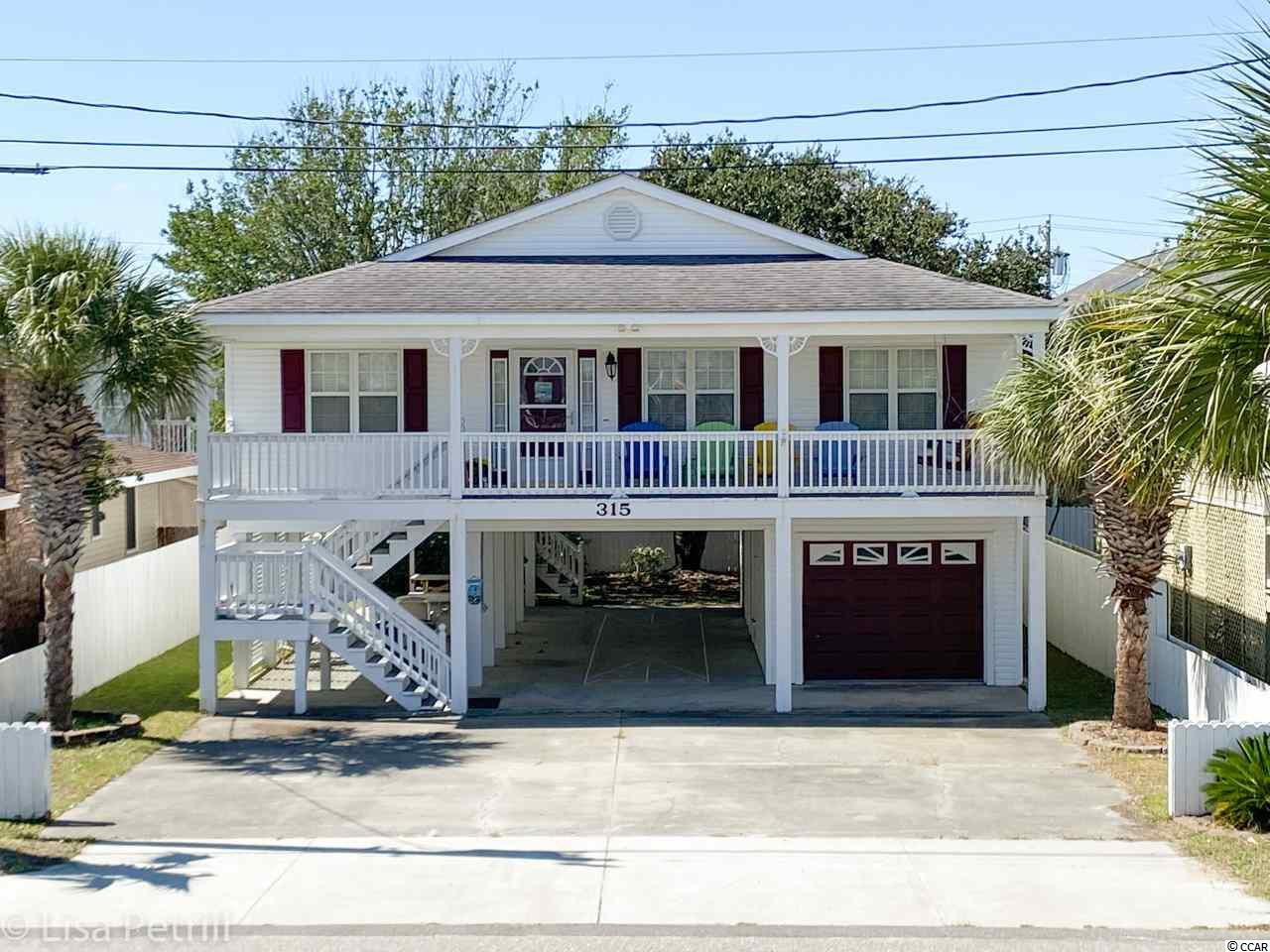 Beautifully decorated Beach Home in Cherry Grove. This 4 bedroom 2 bath home is just 1.5 blocks to the ocean in one of the best beach towns on the Grand Strand. The Home is a classic raised beach house with 2 garages underneath the home one for your golf cart and one for your car or great storage of beach toys. This home was never been rented and has always been used as a 2nd home. The back porch is screened in and the perfect place to relax and enjoy the breeze from the ocean. The interior has been updated and has a warm beach style to come right in and enjoy. This home is being sold furnished so you can just bring your swimsuit and toothbrush. 30th Ave is a short walk, bike or golf cart ride to dinning ,grocery and the gorgeous Cherry Grove Fishing Pier. Don't miss out on this turn key beach home in Beautiful Cherry Grove Beach.