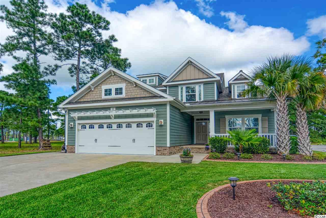Immaculate Custom 4bd/2.5ba home in Gated Waterbridge- only 10 mins to the beach! Lots of room both inside and out becuase this home boasts a large, grassy fenced-in backyard that backs up to trees. Gorgeous extended paved patio with fire pit and large grilling area. This leads right into a screen porch which is actually an all seasons room becuase of the EZE Breeze window update. Inside you will love the open concept! Carolina Room with Fireplace bumps right up the a Large Great/Family room with Eat-in Kitchen w/ office area & separate dining room.  Plus the Spacious Laundry Room is right off garage door entry and foyer which is popular with families.  Master on 1st floor.  3 bedrooms up PLUS a large Landing or Bonus Room perfect for gaming, tv etc. Built in 2017, this home boasts lots of upgrades including energy efficient windows & appliances and LED lighting. Waterbridge owners enjoy access to the beautiful clubhouse with the Largest Community Pool in our area complete with lounging areas and fitness center. Enjoy the community boat dock and launch, community boat storage, RV storage and the option to have access to the oceanfront Atlantica Resort.  Atlantica amenities include oceanfront pool and indoor pool, sun deck, indoor and outdoor hot tubs, children's pool, and lazy river. Waterbridge is just a short drive to everything Myrtle Beach has to offer including Coastal Grande Mall, Tanger Outlets, marinas, public docks, landings, restaurants, golf courses, shops, entertainment, Myrtle Beach International Airport, Broadway At The Beach, The Market Common, Barefoot Resort and Coastal Carolina University (CCU). Also, only 90 miles to beautiful Charleston, SC!