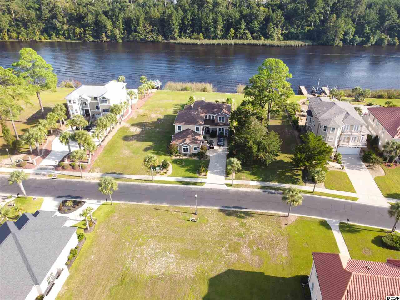 Residential lot 2nd row to the ICW in the GATED community of The Bluffs on the Waterway in Carolina Forest- only 10 mins to the ocean! NO time limit to build. Bring your Builder! Owners enjoy access to the community boat ramp, boat dock, tennis court, playground, 2 beautiful clubhouses, outdoor pools, and gated storage area- perfect for storing your boat or RV. The neighborhood also has a lake that is great for fishing, kayaking, and enjoying nature. There is also a trail that is perfect for biking, walking or golf carting over the ICW straight to the ocean. The HOA allows pets and the ability to install fences & pools with prior approval. Motorcycles, boats, golf carts, and commercial vehicles are welcome! Carolina Forest is just a short drive to everything Myrtle Beach has to offer including Coastal Grande Mall, Tanger Outlets, marinas, public docks, landings, restaurants, golf courses, shops, entertainment, Myrtle Beach International Airport, Broadway At The Beach, The Market Common, Barefoot Resort and Coastal Carolina University(CCU). Also, only 90 miles to beautiful Charleston, SC.