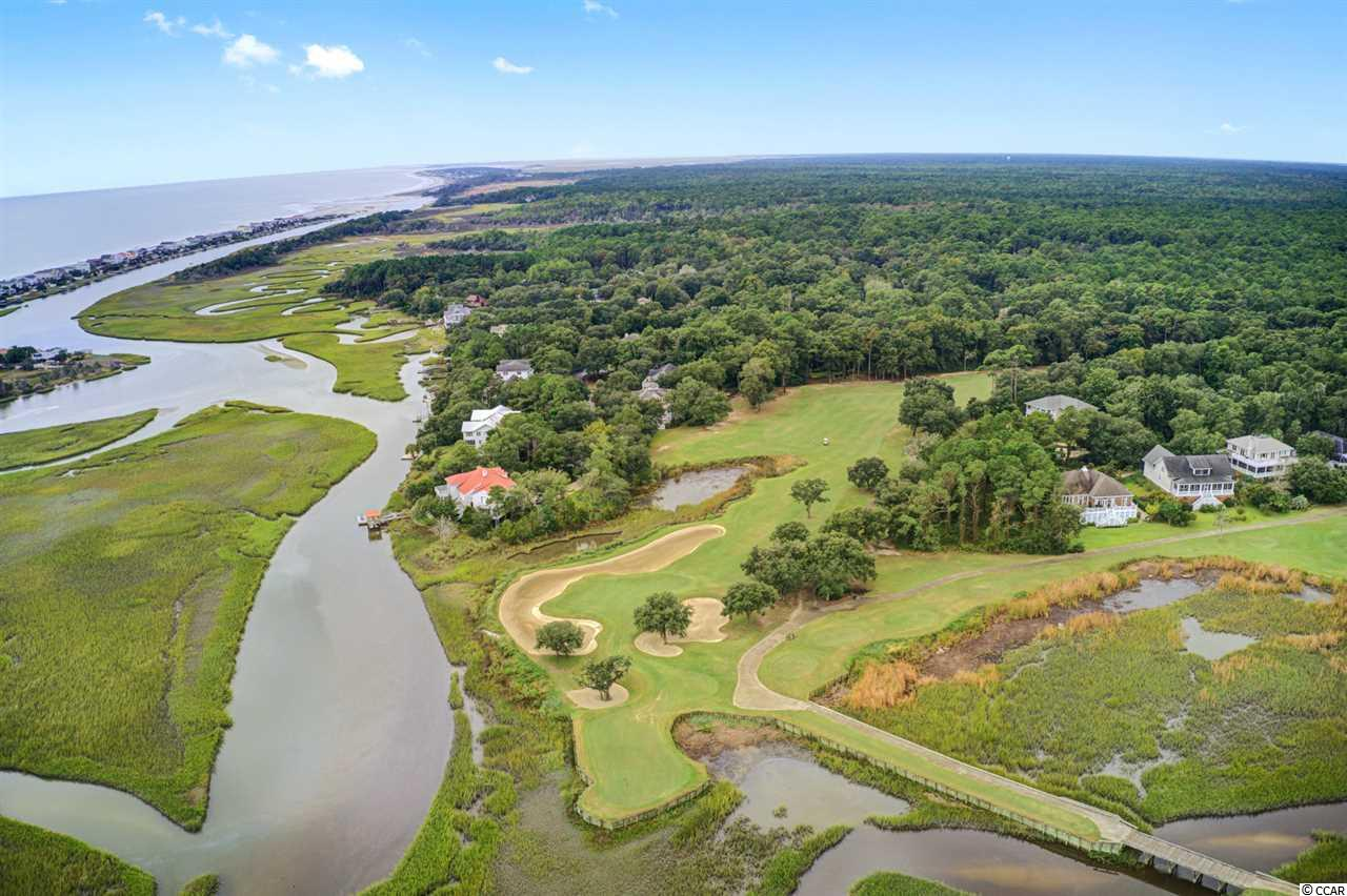 Rare Opportunity to build in the gated community of  Pawleys Plantation, featuring a Jack Nicklaus designed golf course.  Other amenities at the Plantation for members include; tennis, the clubhouse, dining, pool and gym. Only 7 minutes from the grocery store, and other downtown Pawleys Island shops, you have everything you need on the island!  Located at the end of a quiet, cul-de-sac this .35 acre lot, is already set up for city sewer and water. The lot is already leveled, and backs up to the water for you to add your own private dock to. Enjoy all the fishing, wildlife, and water activities this property can give you. Plenty of space to build your dream home, or just your summer vacation spot! The choice is yours, but don't miss out on this opportunity! This won't be on the market for long.  Use preferred lender to buy this home and receive an incentive towards your closing costs!