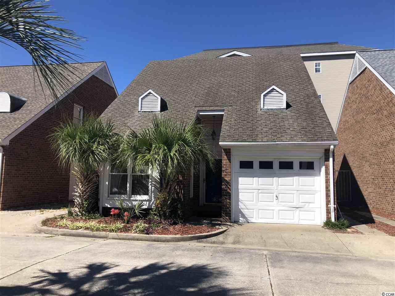 DIAMOND IN THE ROUGH ONLY 2 BLOCKS TO THE BEACH! This 3BR/2BA all brick home is in Courtyard Villas By The Sea, a quaint community with only 10 unique homes. This Home has lots of potential and features a fireplace in the family room and also in the 2nd floor master bedroom. 2 bedrooms on 1st floor and 1 full bath. Good sized Dining area in Kitchen. Large Master Bedroom (24 x 14) on 2nd floor with fireplace, masterbath has double sinks, separate shower and jacuzzi tub. Laundry room on 2nd floor with lots of storage. Private built in pool in Tropical back courtyard. Short walk to beach, OD, MainStreet, dining.. A True Shaggers delight! Property Being Sold in As Is Condition. Square footage is approximate and not guaranteed. It is the sole responsibility of the buyer and the buyer's agent to verify.