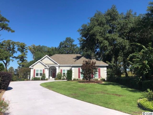 Location, Location, Location. The owner selected this location overlooking the marsh/ricefields and the rear deck is an ideal place to relax in a Pawleys Island hammock. Located at the end of a cul-de-sac on a quiet street close to the owners' clubhouse, tennis courts, fitness room and pool. Three bedrooms, two baths with the current den as the third bedroom. The vaulted ceiling great room is a spacious entertaining space. The master is on one side of the house with an en suite bath and two closets and a view of the marsh and a moss draped oak. The guest bedroom and bath are on the opposite side of the home. Roof replaced in 2012, HVAC is three years old as is the hot water tank and new windows in 2018. Heritage Plantation has a marina with a large gathering deck for sunsets and relaxation and wet/dry boat storage. Close to beaches, boating, a plethora of golf courses including the prestigious Heritage Club, restaurants, medical facilities, schools, shopping, and all that Low Country living has to offer. Square footage is approximate and not guaranteed. Buyer is responsible for verification.
