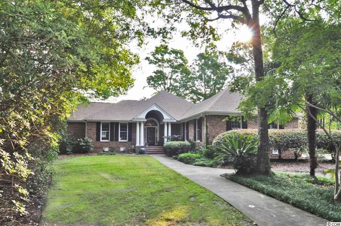 Welcome to 4806 Lily Pond Drive. This home is located in the back of a quiet, cul-de-sac street that backs up to a very private lake for backyard enjoyment year round. The views from the living room and sunroom are what every buyer will remember about this all brick, one level home. The upgrades and meticulous maintenance are evident the minute you pull into the driveway. All outdoor exterior wood was repaired and painted, sunroom windows have been replaced, sliding doors were replaced with French doors, all new interior paint, hardwood floors were stripped and refinished, updated hardware, complete master bathroom renovation, outdoor lighting replaced, and much, much more. This three bedroom home also has three outdoor living areas, built-in BBQ, large mudroom which has a desk space and laundry closet, and the kitchen has granite countertops and stainless appliances. With only a few other homes in Wachesaw Plantation to choose from, make sure to put this home on your list to see before it's too late. Wachesaw Plantation is a gated community, with 24-hour security guards, a Tom Fazio Private Golf Course and Tennis Club, a private pool area and multiple dining/bar venues (Kimbels, Magnolias & Clubhouse) which overlooks the Waccamaw River/Intracoastal Waterway. Please take a look at the Matterport 3D Virtual Tour on the listing or by copying and pasting the link here: https://my.matterport.com/show/?m=wQWnk9sRQwx&brand=0