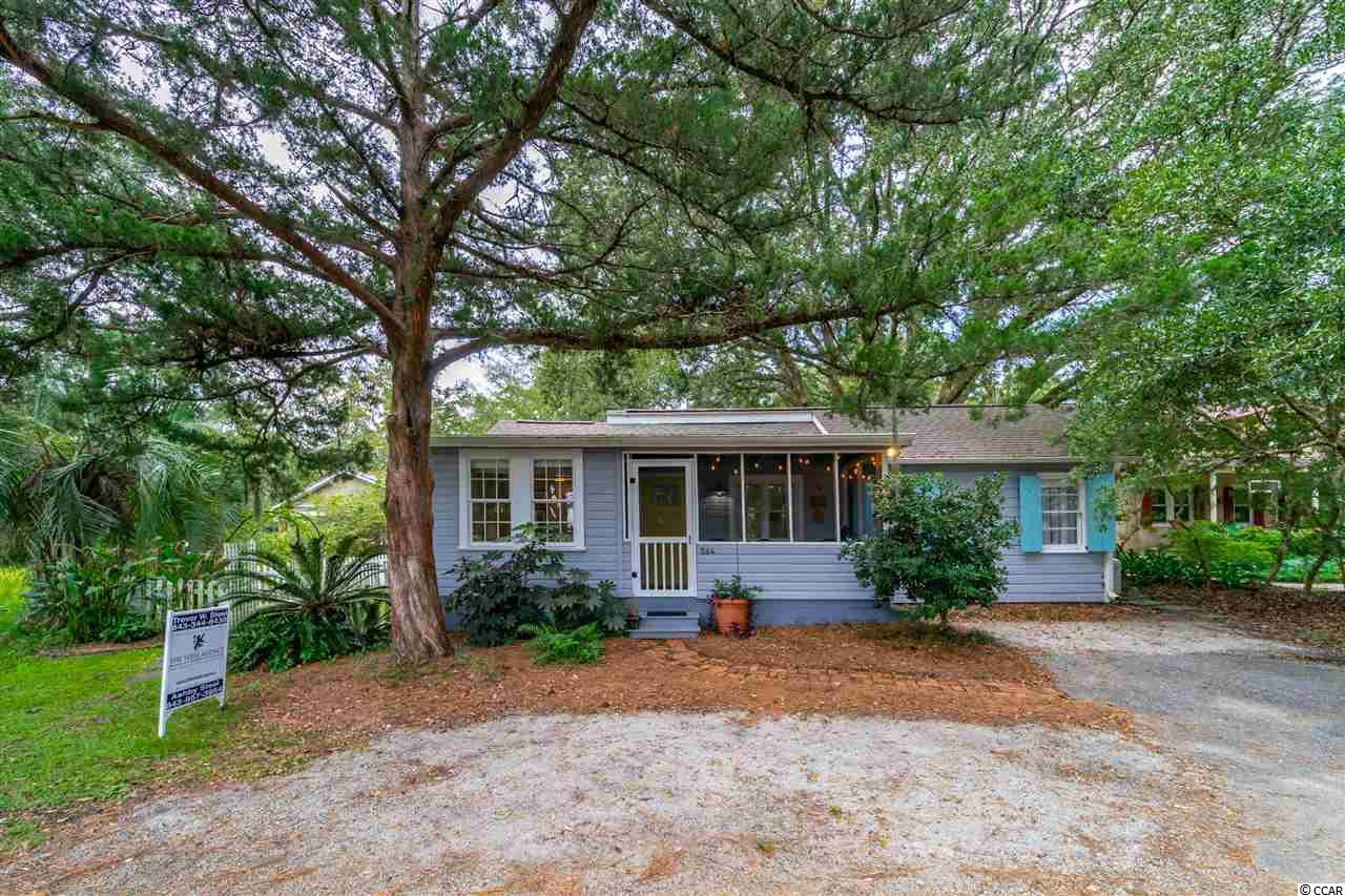 What an amazing opportunity to own a true Pawleys Island cottage. Walk to the Beach or fish and crab from the South Causeway bridge. Located in the heart of Pawleys Island with huge live oak tree in the backyard. Enjoy the view of Pawleys Creek marsh from your front screened in porch. This absolutely charming 3 bedroom home was built in 1950 and holds all of it's original character and charm but was completely updated and renovated from top to bottom in 2016. This home has new LVP floors perfect for durability and easy cleaning when coming off the beach. New ceilings, walls, HVAC and roof. A brand new updated kitchen with granite counter tops. Both bathrooms are new, new, new! Home has a Rinnai tankless hot water heater. This home is move in ready and will not last long. Great vacation rental property as well.