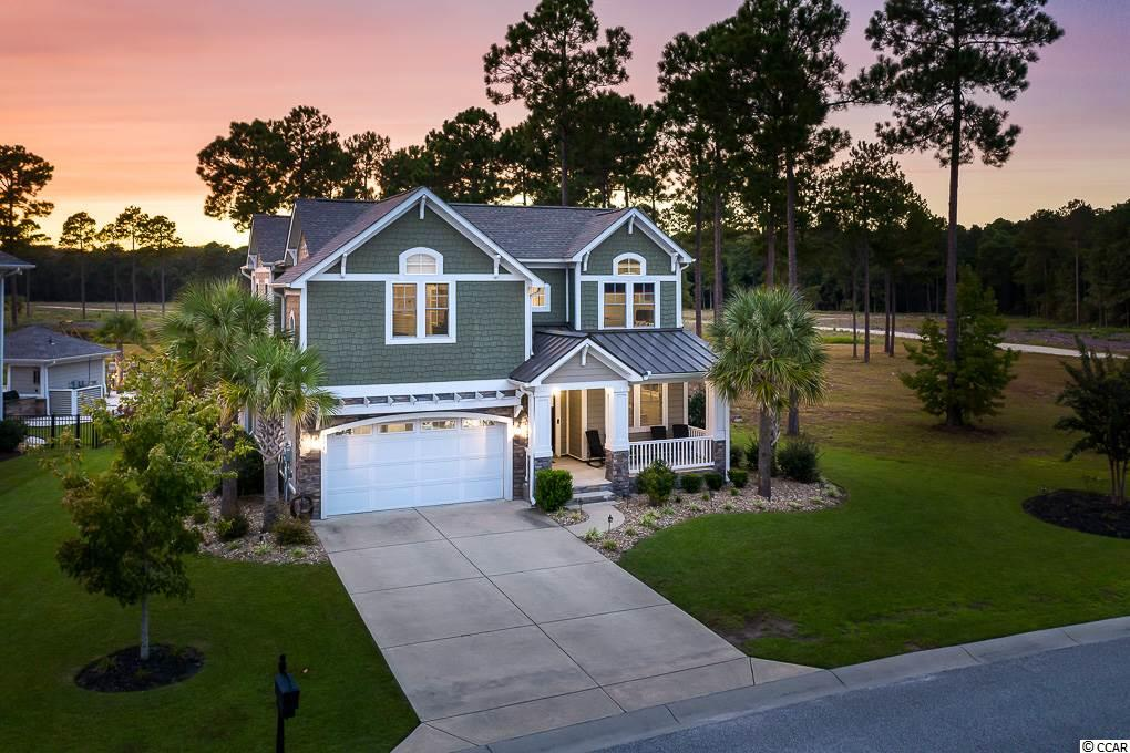 Step inside this completely customized home in Carolina Forest's gated Waterbridge Community.  The community features 80 acres of navigable lakes, resort style amenities center, 24 hour fitness center, clubhouse, tennis courts, sand volleyball court, basketball courts, pickleball courts, bocce ball and a community boat launch into Palmetto Lake.  You may never venture outside of your new neighborhood!  This beautiful home offers open concept living on a beautiful, fully fenced lot overlooking the lake.  Step inside to the grand two story foyer leading to the home office and formal dining room.  The main level also features a gourmet kitchen complete with commercial style refrigerator, wine fridge, built in wine racks, butler's pantry and more!  Outdoor entertaining is a breeze on the large outdoor porch.  Too cool?  Step inside and entertain by the fire in the welcoming family room.  Four spacious bedrooms upstairs along with a loft space already plumbed for an additional bathroom offer all the space you need to spread out!  Serenity awaits in the large master suite with private balcony, custom walk in closet, and spa like en suite.  Tons of extras in this custom floor plan!  All of this on a corner lot offering the rare opportunity to have only one neighbor!  Contact your real estate professional and schedule your showing today!