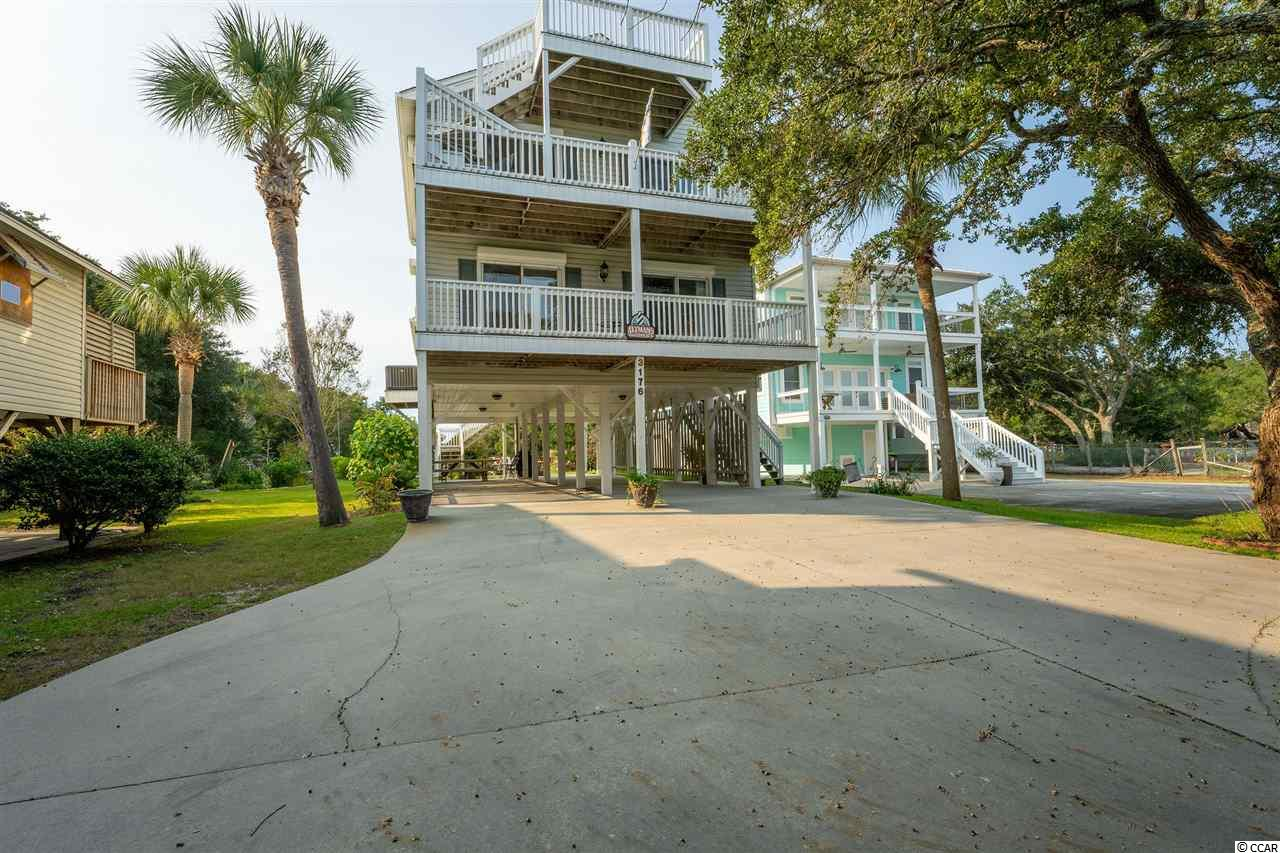 This beautiful home on the Murrells Inlet marsh that also backs up to the creek is one you don't want to miss. Stunning views of the Inlet in front and a private floating dock in the back. The house is on a large elevated lot which is a huge advantage living on the inlet plus NO HOA. There a detached storage shed in the back. The windows have built-in hurricane shutters that simply pull down for convenience. There are 4 bedrooms and each bedroom has it's own private bathroom. Two bedrooms on the main level and two on the second floor. The open floor plan is spacious with hardwood floors and tile in the kitchen with new granite counter tops. New roof in 2016 and HVAC's are 2017 & 2018.  This house is located towards the end of a cul-de-sac street that's quiet with plenty of privacy. Close proximity to the beach since there was a golf cart path put in about 2 years ago. Screened-in porch in the back with relaxing views of the creek and live oak trees. The Murrells Inlet restaurants, Hunington Beach State park and Brookgreen gardens are less than 5 minutes away. This house is has never been rented and in immaculate condition.
