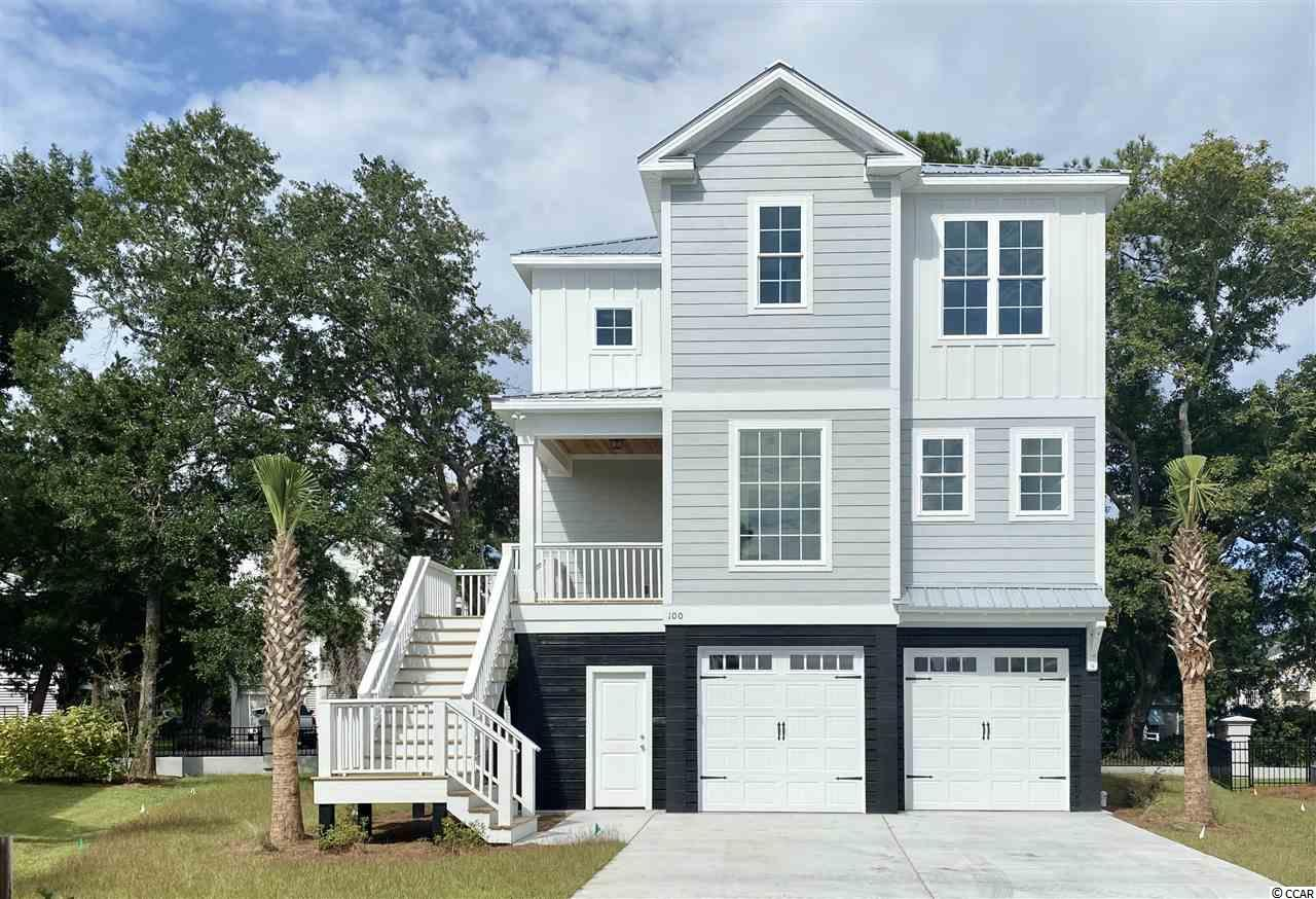 BRAND NEW HOME~ 3 bed 2.5 bath custom built home with tons of upgrades! Located in the heart of Murrells Inlet, South Bay Village is a 33 lot raised beach cottage community surrounded by an elegant wrought iron and stucco fence featuring two community fountains and just minutes away from everything Murrells Inlet has to offer.  Ride your bike or take a golf cart to the beach or down to the Marsh Walk and enjoy the fresh breeze or check out all of the great local restaurants, watch the boats come in from fishing all within a short distance of your new home!! Some of the features include: tankless RENAI hot water heater, stainless appliances, beautiful tile baths, fully landscaped yard with palm trees and irrigation, metal roof, hardi plank siding, back patio, and much more!  Be sure to tell your realtor to add this one to your list!!