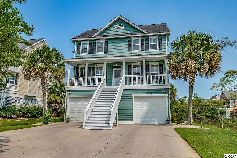 "Fantastic raised beach home just steps from the ocean with an oasis in the backyard.  This 4 Bedroom 4.5 Bath home features plenty of room to entertain with a great layout. There are hardwood floors through the living room, dining room, & family room & master bedroom as well as crown molding & plantation shutters throughout.  The kitchen features tiled floors with an inlay, stainless steel appliances, trash compactor, hot water dispenser, granite countertops, 42"" cabinets with pull out shelving, and work station right off the kitchen.  The living room/family is separated by a double sided fireplace to provide ambiance in both rooms.  The master bedroom suite has double sinks, soaking tub, separate shower, & large walk-in closet.  The home was built with an elevator shaft in place & wired for easy installation of an elevator.  This home is perfect for those who want to spend time outside with the beautifully landscaped & fenced back yard with a 16x32 concrete pool with 10x16 wet deck with paver decking.  Enjoy sitting by the outside fireplace or grilling in your built in BBQ.  Under the front steps is an outdoor shower for rinsing off after trips to the beach as well.   Under the home is plenty of storage in the oversized garage with 9'6"" doors for extra clearance.  There is a heated/cooled bathroom on the ground floor as well as plenty of room to park multiple vehicles, boats, and even a workshop.    This wonderful home is located close to shopping, golf, restaurants, area attractions and only a few minutes away from Myrtle Beach State park and The Market Common.  Square footage is approximate & not guaranteed.  Buyer is responsible for verification."