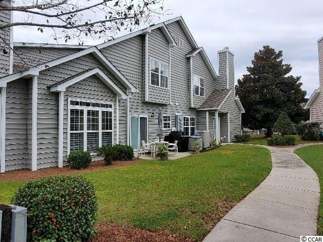 Enjoy life in this spacious 1600 SQ FT 3 Bedroom - 2.5 Baths condo in FAIRWAY OAKS - North Myrtle Beach. This beautiful LAKEFRONT unit is siting on one of the best views in Fairway Oaks!  Located only a few blocks from the Atlantic Ocean. This GOLF CART FRIENDLY neighborhood is only minutes from grocery stores, pharmacies, shopping, restaurants,and all of the Myrtle Beach attractions. Very convenient beach access from 20th Avenue in the CHERRY GROVE section of North Myrtle Beach. Only minutes to the new Coastal North Shopping center by golf cart or bicycle. This exquisite property features an open floor plan, vaulted ceilings, and abundance of windows provide spacious living/dining/kitchen areas, ceramic tile floors, double-sink bathroom vanities, large bedrooms w/ walk-in closets an so much more. Access to patio from dining area with sliding glass door. Large Master Bedroom includes ceiling fan, spacious walk-in closet, extra linen closet. Two large guest bedrooms upstairs (additional walk-in closet) with full bathroom and linen closet. Extra storage space throughout. Perfect for a 2nd Home or future retirement location.Neighborhood amenities include clubhouse with swimming pool and spa. Coastal living at its finest!