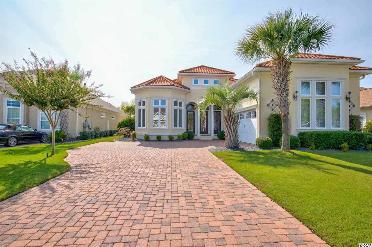 """Awesome! If you're searching for an appealing and impressive home on a primer lot featuring exclusive backyard privacy and the availability of numerous outdoor community amenities; this 4 bedroom, 3.5 bath Mediterranean masterpiece may become your destination of choice. Located in the highly desirable and gated Intercoastal Waterway subdivision; """"The Bluffs on the Waterway"""" has all the amenities you are looking for in a Coastal Community.This home boasts a uniquely open floor plan and greets its owner(s) and guests with an expansive 19' high foyer and a cleverly attached study/music/sitting room. Impressive hardwood floors throughout the first floor enhance the stately yet welcoming ambiance. From the foyer, you'll see a large comfortable living room area with an eye catching and impressive coffered ceiling and gas fireplace. The rear wall features a series of French doors that provide light and a feeling of openness to the space along with views of that very private backyard.  The kitchen is a chef's delight and an entertainer's dream! This space is highlighted by upscale stainless steel appliances and venting hood, gorgeous granite countertops, an extra spacious entertainment/dining island, custom cabinets, breakfast nook and a butler's pantry.A formal dining room features a 9' trey ceiling and is anchored by a beautiful chandelier. A discreetly positioned and spacious mud room providing closet space galore for both convenience and storage. This home offers two Master Bedrooms! The first floor Master is large yet cozy and boasts a tray ceiling, sitting area, two walk-in closets plus a set of French doors leading to the porch.The Master Bath is equally impressive. It features an oversized walk-in shower, dual sinks, beautiful cabinetry and of course, granite countertops. The second story floor plan is surprisingly large, versatile and unique. A game/tv/play/room, 3 bedrooms, 2 baths, including the second Master bed and bath, make the area an oasis for the entire fa"""