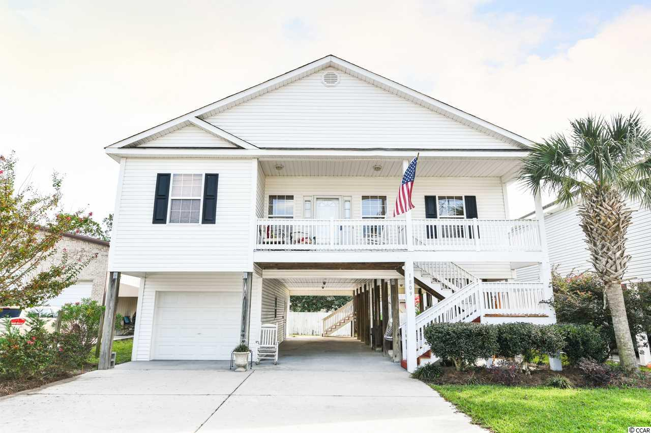 Come relax in YOUR DREAM home, four bedrooms and 3 baths, with a wide open floor plan, laminate flooring, ceramic tile in bathrooms, 9' and 10' ceilings and crown molding throughout. Nestled just steps away from the beach and close to all the NEW shops, restaurants, and attractions that North Myrtle Beach has to offer!! This raised beach house has an enclosed garage with lots of storage, plenty of parking space, large front porch and also a screened in back porch. This GEM could be YOURS...make an offer today!!