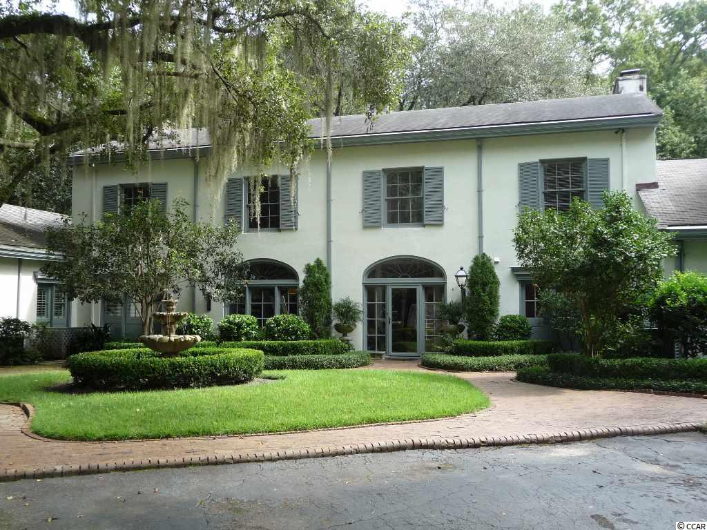 Beautiful, French designed home including 3 bedrooms, 3 1/2 baths located in historic Litchfield Plantation. Borders the Waccamaw River which gives river & ocean access along with the opportunity to lease a boat dock. This home has been newly renovated throughout. It offers 9 foot ceilings on both levels, authentic brick floors, 4 fireplaces, a first floor office with a separate entrance, 2 master suites, main master bath includes double vanities with custom water feature & walk-in closet. Custom cabinetry: millwork and built-ins throughout the entire home, including crown moulding, coffered ceiling in dining area with coffee bar & separate wine bar, granite throughout kitchen & baths. Upgraded stainless appliances. Level 1 offers the authentic brick floors with marble floors in kitchen & bathroom. Level 2 offers new carpeting, with marble floors in baths. 3 sets of French doors, leading to a beautiful brick patio with views of lake/pond. Outdoor living area includes kitchen with bar, refrigerator/freezer, & wine refrigerator, & dining area. Large covered Pergola with paddle fan, speakers & lighting for nighttime, including gas fire pit area. LP Community private amenities include gated security, marina on International Coastal Waterway, usage of LP's ocean-front beach house, original plantation house, swimming pool & facilities. Prequalified buyers only. No dreamers or sightseers.