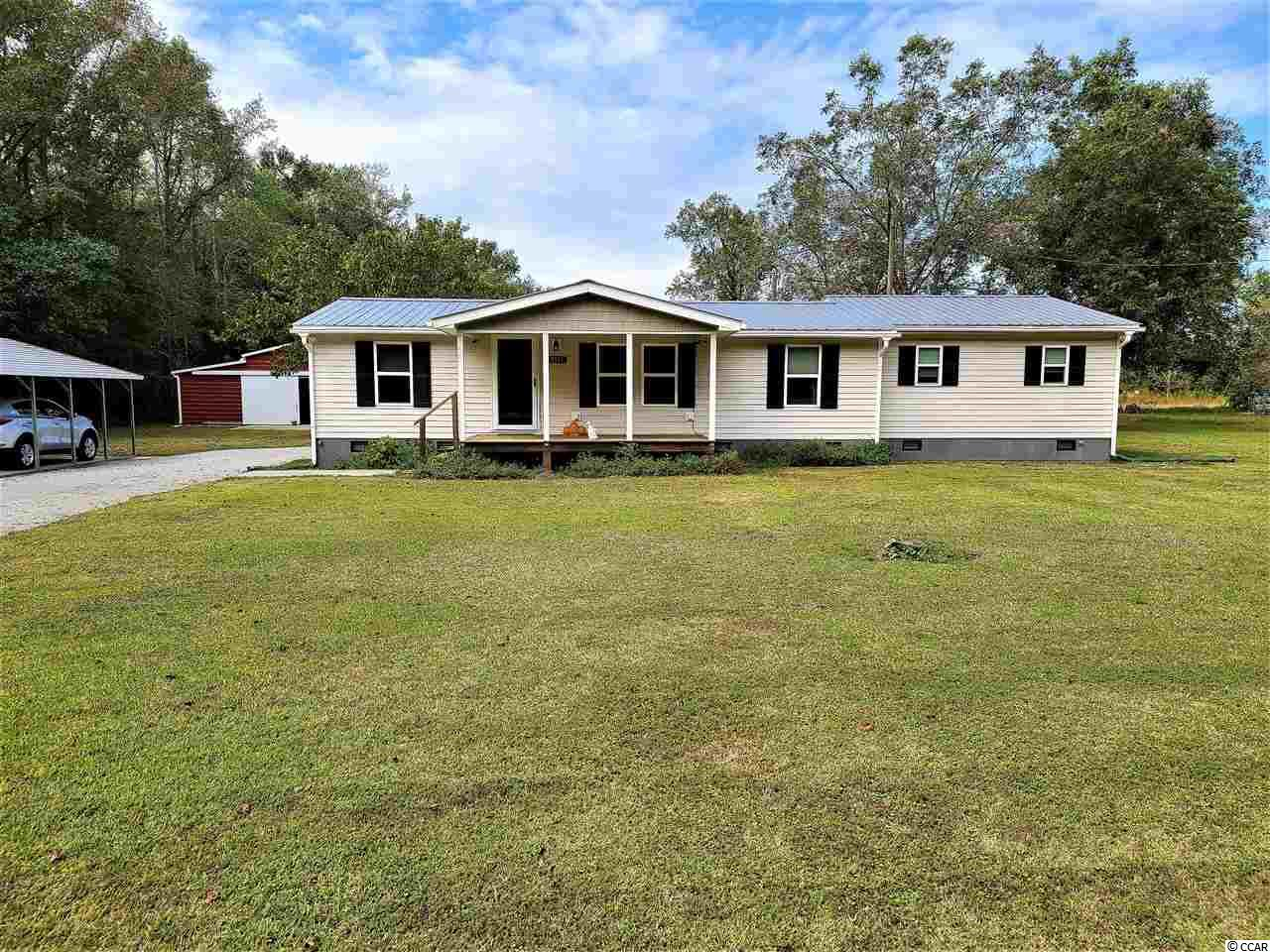 """Welcome Home! This one of a kind property is waiting on you. Property features 3 bedrooms, 3 full bathrooms, huge master bedroom, sun room/ reading room and so much more. Home is sitting on 1.5 acres and features a 48x 42 metal barn with 12x24 tool/ tack room and 6 stalls and also a safe house """"bomb shelter"""" on property. Schedule your showing today."""