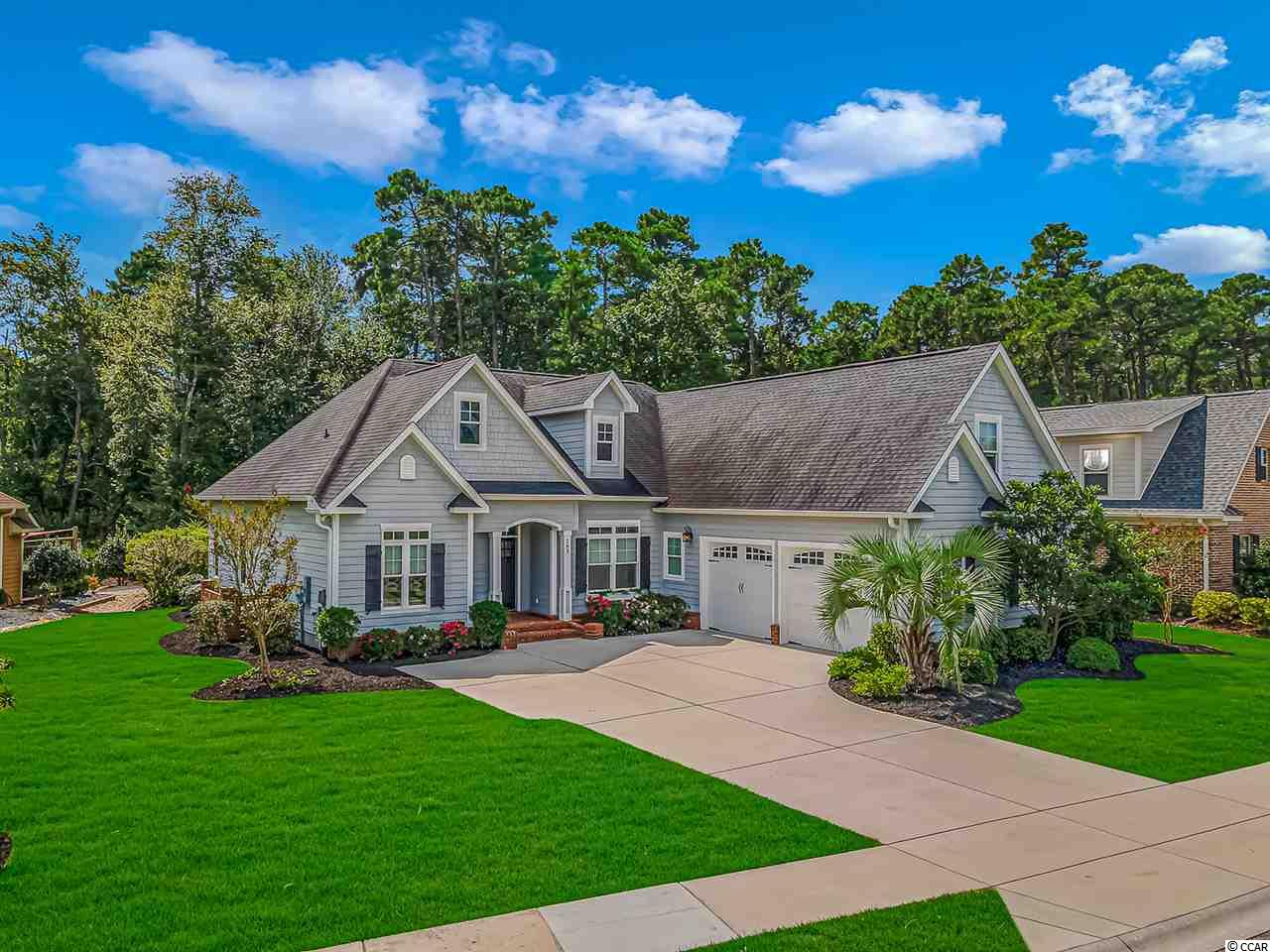 We welcome you to see this 4-bedroom, 3 full bath Low Country home in the highly sought-after community of Plantation Lakes. With great curb appeal, a split bedroom open floor plan and over 2400 feet of living space, there is nothing lacking in this meticulously cared for, fully upgraded custom home.  Entering the formal foyer, you will notice new luxury plank flooring throughout, 10 ft ceilings and plenty of windows providing natural light in the family room, dining room and kitchen. The family room is large with a built-in fireplace and access to a large screened-in porch. The dining area features picture-frame wainscoting and chair railing. The kitchen boasts stainless steel appliances, granite counters, custom off-white staggered all wood cabinets, soft close drawers and, of course, what is a kitchen without a generous work island? There is even a built-in desk for paying bills or completing homework assignments.  The large master bedroom offers a tray ceiling, hardwood floors and his and her walk-in closets with custom built shelving. The master bathroom has a cathedral ceiling, double sink vanity, a generous linen closet, a large tiled shower with bench seating and a beautiful cast iron, claw foot, tub for those peaceful and relaxing candlelit evenings sipping a glass of wine.  This home is truly a custom home with extra details everywhere such as extensive custom moldings, pocket doors and upgrade finishes. There is even new carpeting in the guest bedroom as well as the upstairs bonus/4th bedroom and energy saving skylights in the family room.  Other features include a remote controlled irrigation system, gutters with downspouts, 2 HVAC systems, a solar powered hot water system with 2 tanks, solar panels that significantly reduce energy costs and a backup generator. Privacy is assured as the home backs up to a conservation area.  If you are looking for a community to call home that is more than just a neighborhood, Plantation Lakes fits the bill. Living here is a LIFESTYLE, as the community has a club house for social activities with a gym; 2 large swimming pools, a kiddie pool and playground; a day dock; lighted tennis and basketball courts; sidewalks and, of course, those pristine navigable lakes that have 15 miles of shoreline.   Plantation Lakes is in Carolina Forest close to shopping, restaurants, award winning schools and medical care. Add convenience to gorgeous golf courses, entertainment, the airport and, of course, our most beautiful natural resource… the beach, and you can see why Plantation Lakes is one of the most desirable communities on the Grand Strand.  Don't forget to click on Virtual Tour for an online showing of this exciting property.