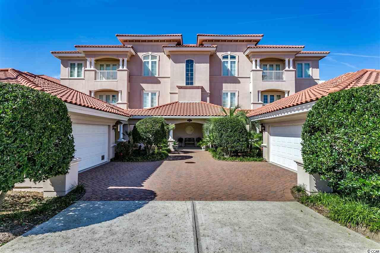 This is your best opportunity to own a beautiful high-end Villa Firenze condo over the bridge in the premier gated community of Grande Dunes. Upon entering the foyer, you're greeted with spectacular views of the prestigious Resort Course, charming cart bridge, and ponds. As you approach the wraparound Carolina Room and enter through either set of French doors, you'll enjoy a fantastic view of the first hole from tee box to green!  It's what you don't see that is equally important; this uniquely placed building eliminates views of other buildings, maximizing the panoramic vista of beautifully landscaped common areas, golf course, and extended view of the driving range and clubhouse. This spacious 3 bedroom, 3 bath unit features over 3400 square feet of enjoyable living space, highlighted by 10 foot ceilings and luxurious appointments throughout. The living area showcases an open floor plan, perfect for entertaining guests, with remote control gas fireplace, granite wet bar, custom built-in cabinets and bookcases with hidden access to power, and adjoining formal dining room with lovely views. Chefs will enjoy the delightful kitchen featuring granite counters and bar, pullout shelves in many cabinets, work island, stainless appliances, and picturesque breakfast nook.  The master bedroom suite highlights include its impressive size, 2 large walk-in closets with extra storage space, and double doors opening up to the spectacular vistas from the Carolina Room. The adjoining master bath features dual vanities, jetted tub, and separate walk-in shower. Each of the other generous bedrooms enjoys a walk-in closet and attached bathroom, richly appointed with tile and granite. Notice many upgrades to this superior home, including the 550 square foot Carolina room with multiple cable outlets and the most amazing sunset views, upgraded flooring, plentiful large closets with extra shelving and built-ins, upgraded ceiling fans, and 3 distinct, convenient entrances. Your private double garage with abundant attic storage is only steps from the backdoor entrance into the home through a personal pavered courtyard where many happy hours have been spent grilling, reading, and napping beside the flowers and fountain. Dues in Villa Firenze are a great value for the full time resident or second home buyer who desires peace of mind and no chores or yardwork. HOA dues include homeowners insurance for the building and interior of the unit, as well as water, gas, cable TV with DVRs and premium channels, and enhanced speed wireless internet. It's hard to beat our very low electric bills in these highly efficient and insulated buildings, even with multiple sets of French doors open year round. Of course, all outdoor maintenance is covered including lush landscaping, reserves to cover painting, roof cleaning and replacement. Have we mentioned the beautiful and exclusive Villa Firenze pool available year round with hot tub, grill and fire pit featuring ample comfortable seating? Top it off with membership in the private, award winning Ocean Club featuring oceanfront pools and hot tub with food and beverage service, as well as multiple beach access points with private loungers and lifeguard. The clubhouse includes dining room with exquisite cuisine and views. Amenity-rich Grande Dunes is one of South Carolina's premier coastal communities, centrally located to dining, shopping, entertainment, and only a short distance to the beautiful Atlantic Ocean. The community includes 2 golf courses, on-site restaurants, deep water marina, tennis facility, and miles of biking/walking trails. There are organized social activities, outings, clubs, service events, and entertainment opportunities for all residents. Welcome to Villa Firenze, the ideal home or vacation spot! With no chores or yardwork, there will be ample time for fun at the beach or golf course, and time to enjoy all the natural beauty and excitement that Myrtle Beach has to offer.