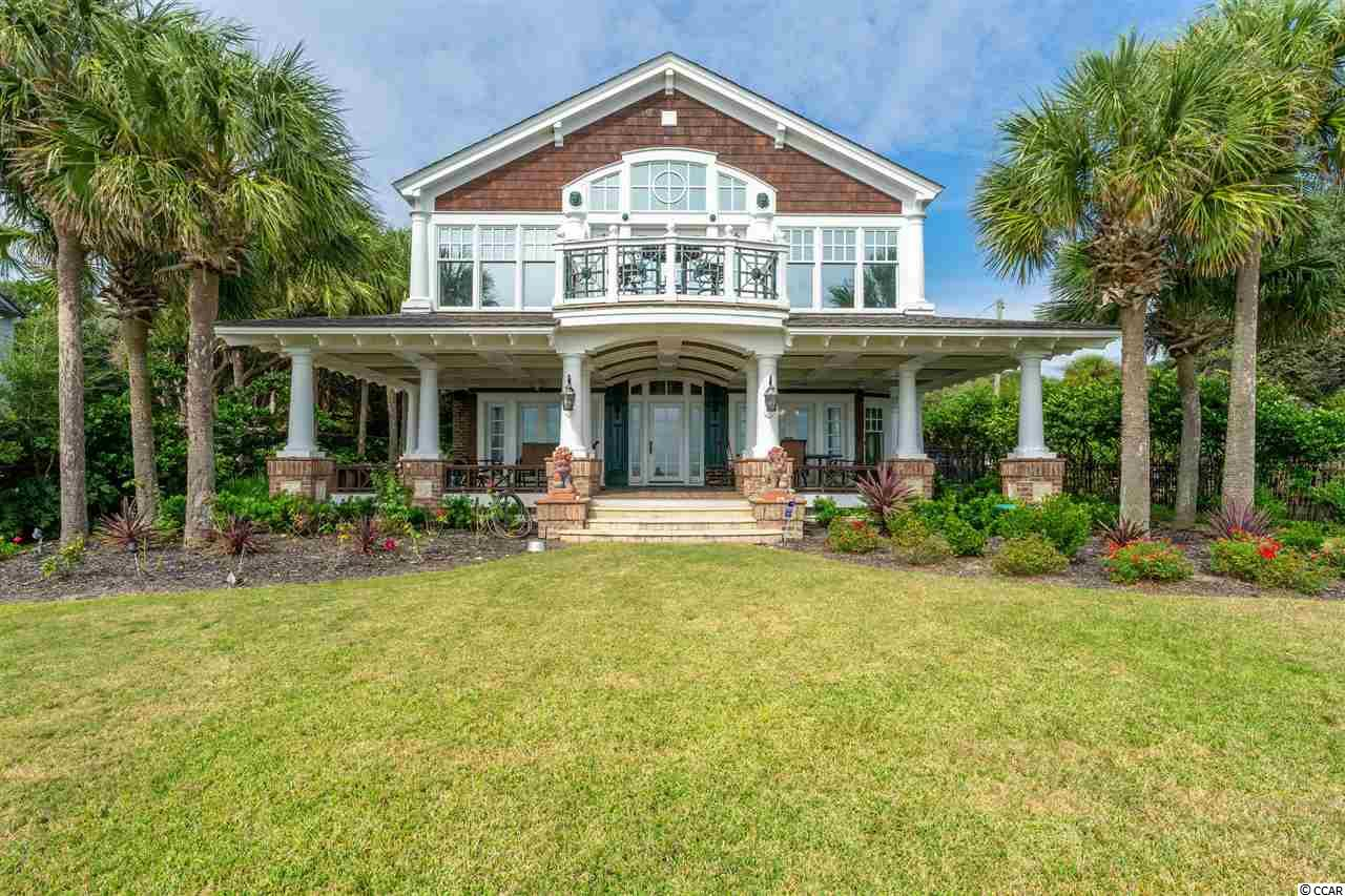 "Located on one of the largest oceanfront lots in the ""Golden Mile""... this home is a ""must see"" for the discerning tastes of those seeking the beach front lifestyle. Dating back to 1939 the home was completely renovated in 1998 and updated once again in 2015. The result is a breathtaking estate comprised of 2 living spaces independent of each other. Located just beyond the front gates is a spacious 2 bedroom, 2 bath Guest house perfect for hosting out-of-town visitors. Whether relaxing in the large family-room, sun bathing on the outdoor deck or swimming in the courtyard pool, there's truly something for every guest to enjoy. Throughout the 2-story, 3 bedroom, 3 1/2 bath main residence you'll find a masterpiece of exquisite Old World charm whose details and mil-work are truly one-of-a-kind! From coffered wood, detailed stenciling, medallions or cathedral...each ceiling is a work of art. This home has it all from the chef's kitchens outfitted with Sub-Zero  refrigerator, Thermador Professional double-oven and range, private beach front master suite with spa-like bath or multiple out-door living spaces...  this is one of the most incredible homes the Grand Strand has to offer!"